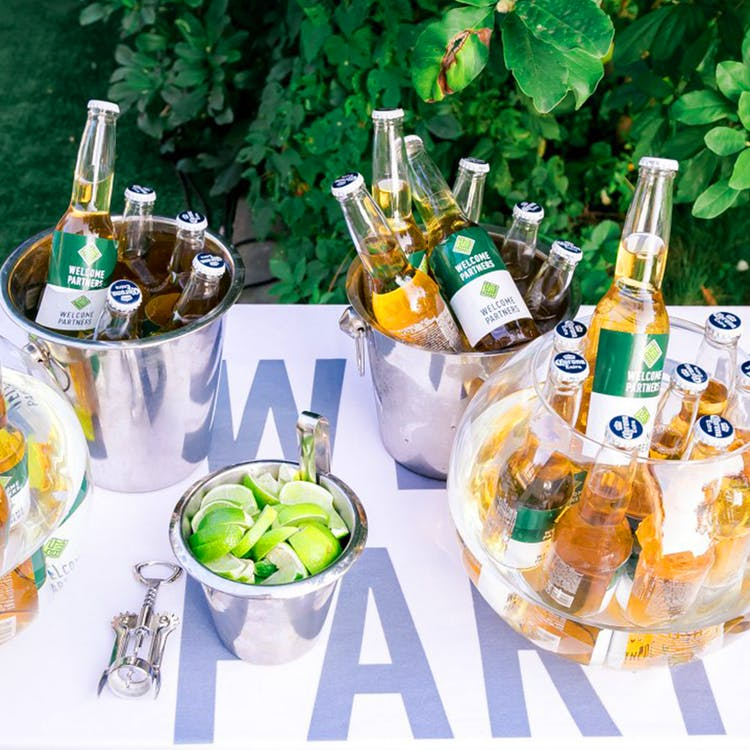 Photography of Beer Bottles on Buckets