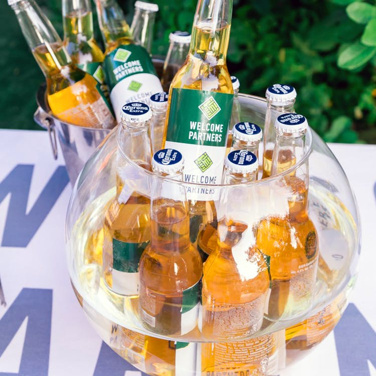 Close-Up Photography of Beer Bottles on Fishbowl