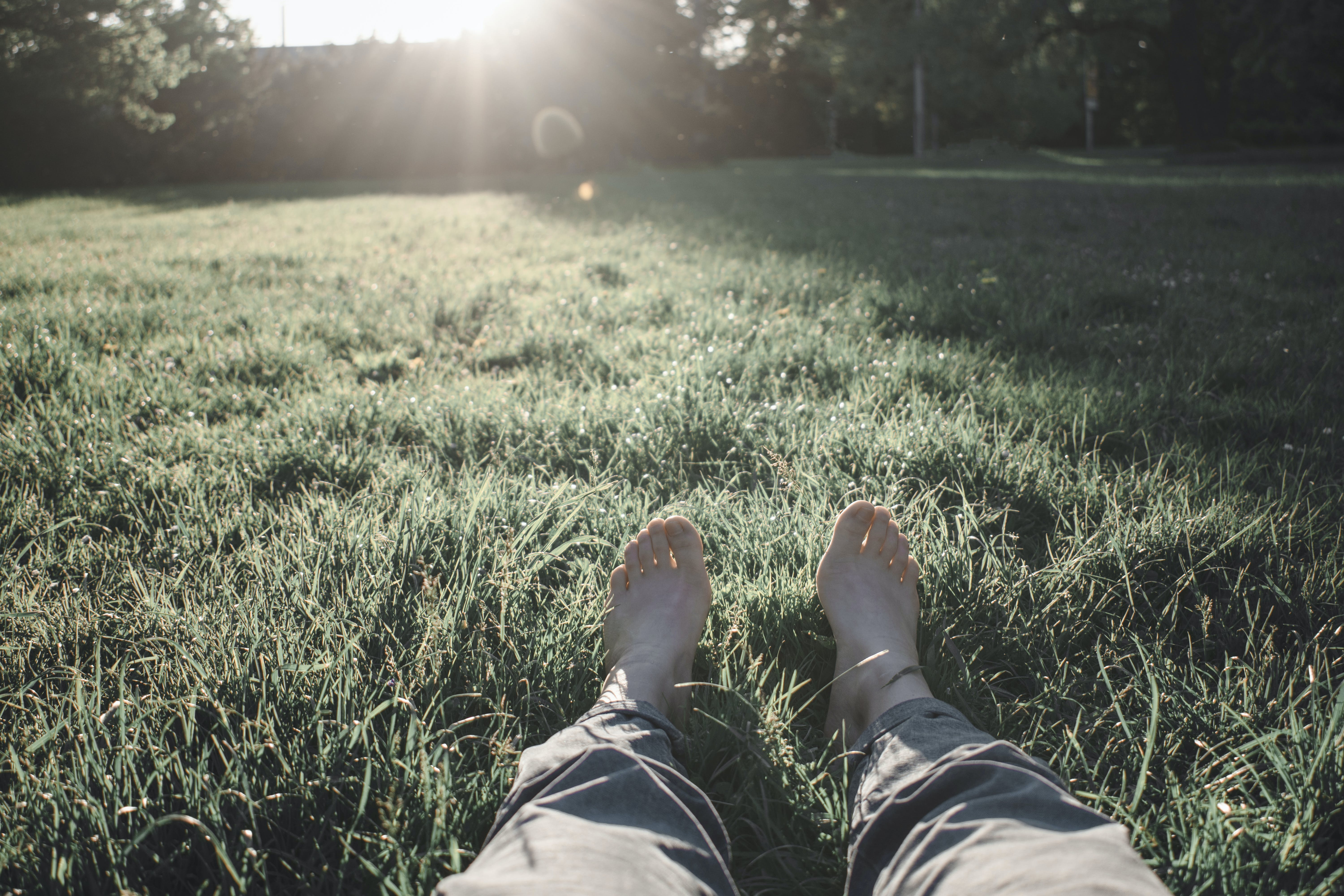 Photo of Person Sitting on Grass Field