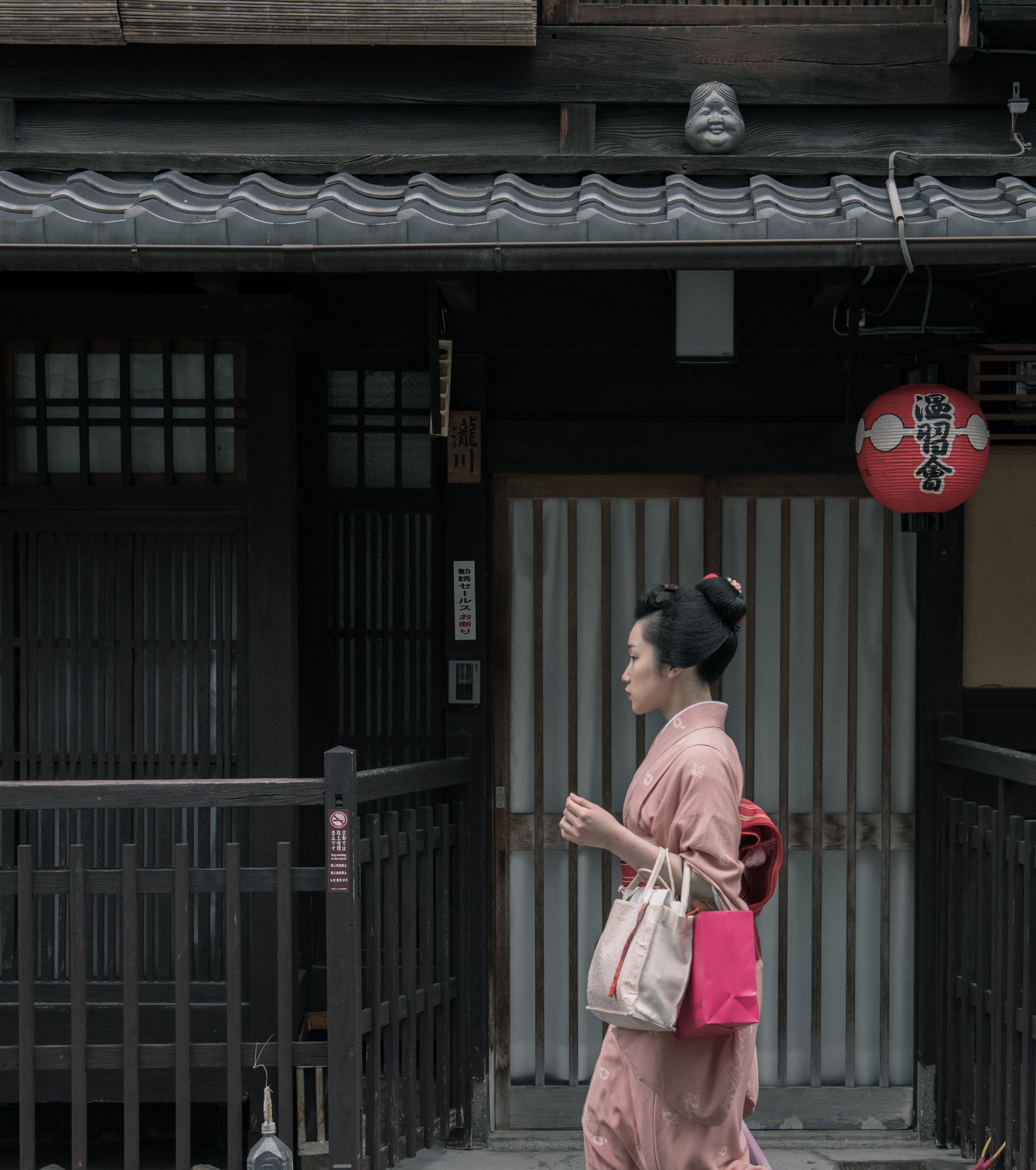 Woman Wearing Pink Kimono Walking Near Houses