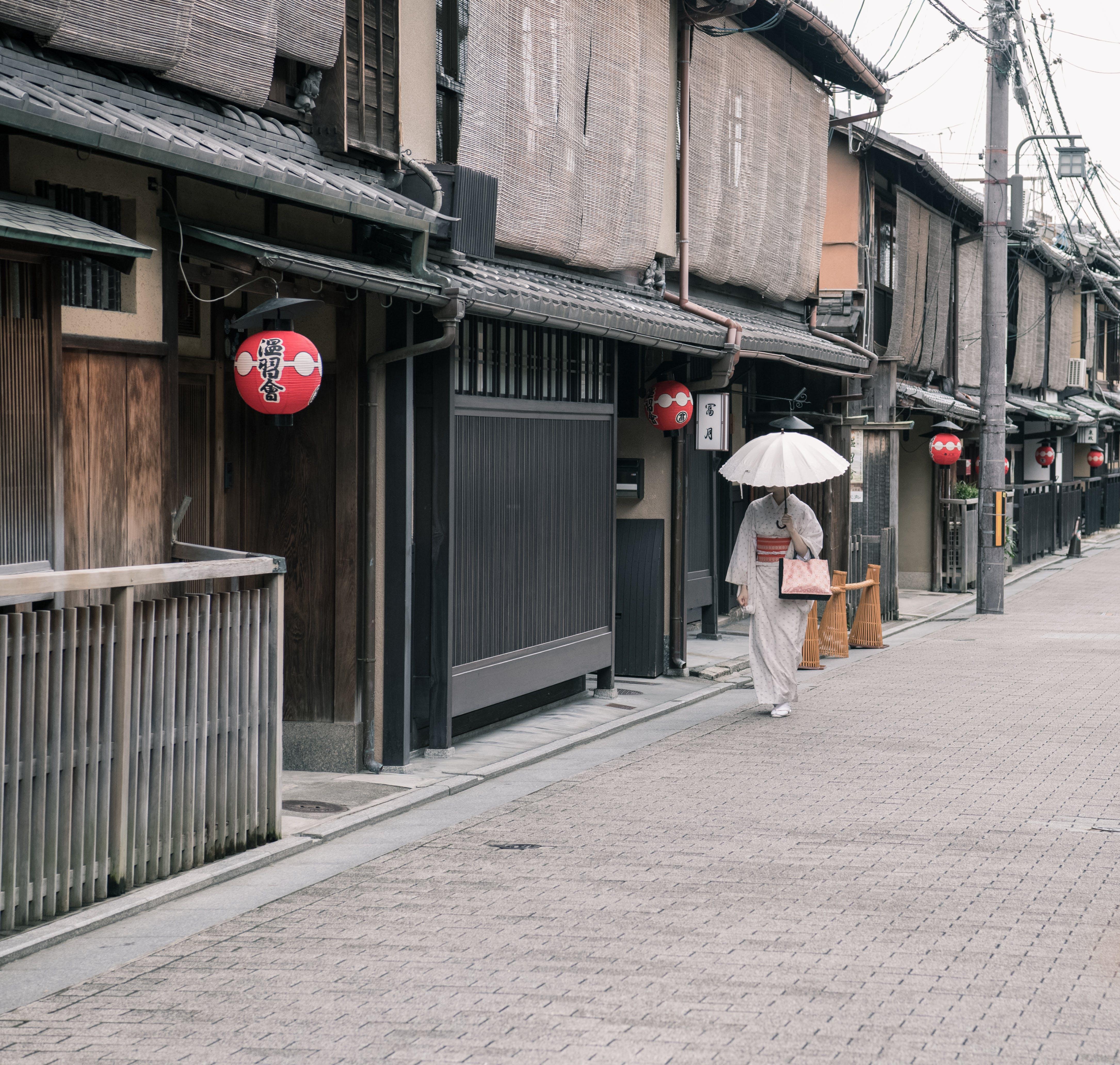 Woman Wearing White Kimono Dress Walking Near Road