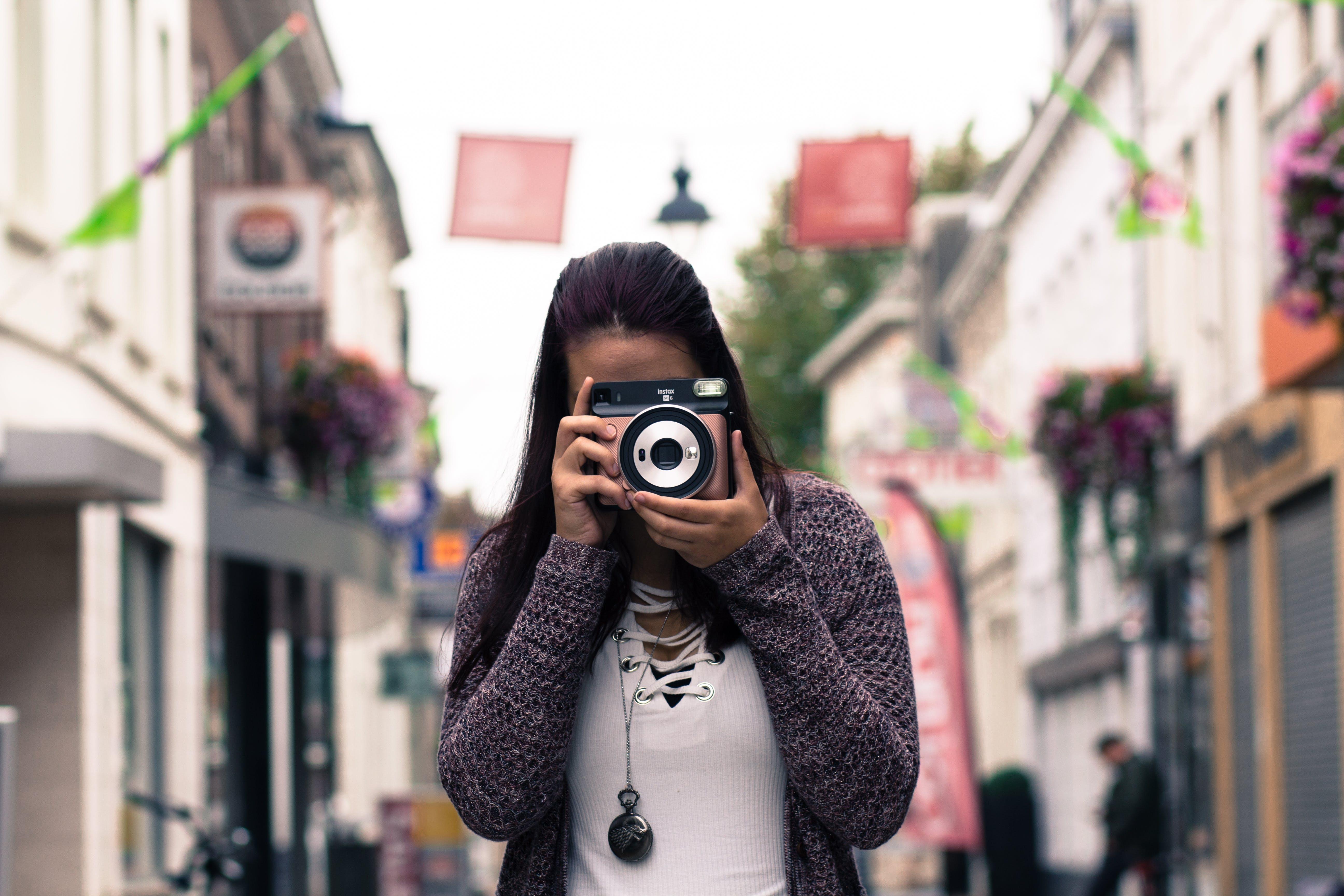 Woman Using Slr Camera Outdoors