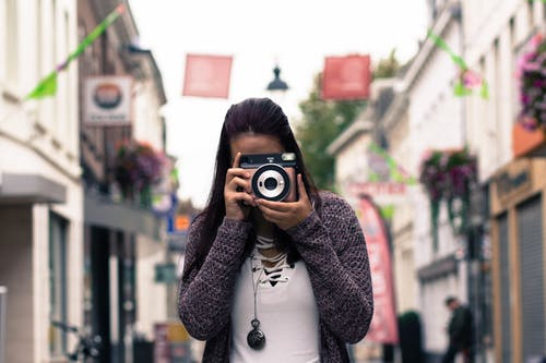 Woman Using Slr Camera Outdoors