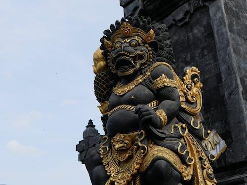Kostenloses Stock Foto zu gold, religion, schwarz, statue