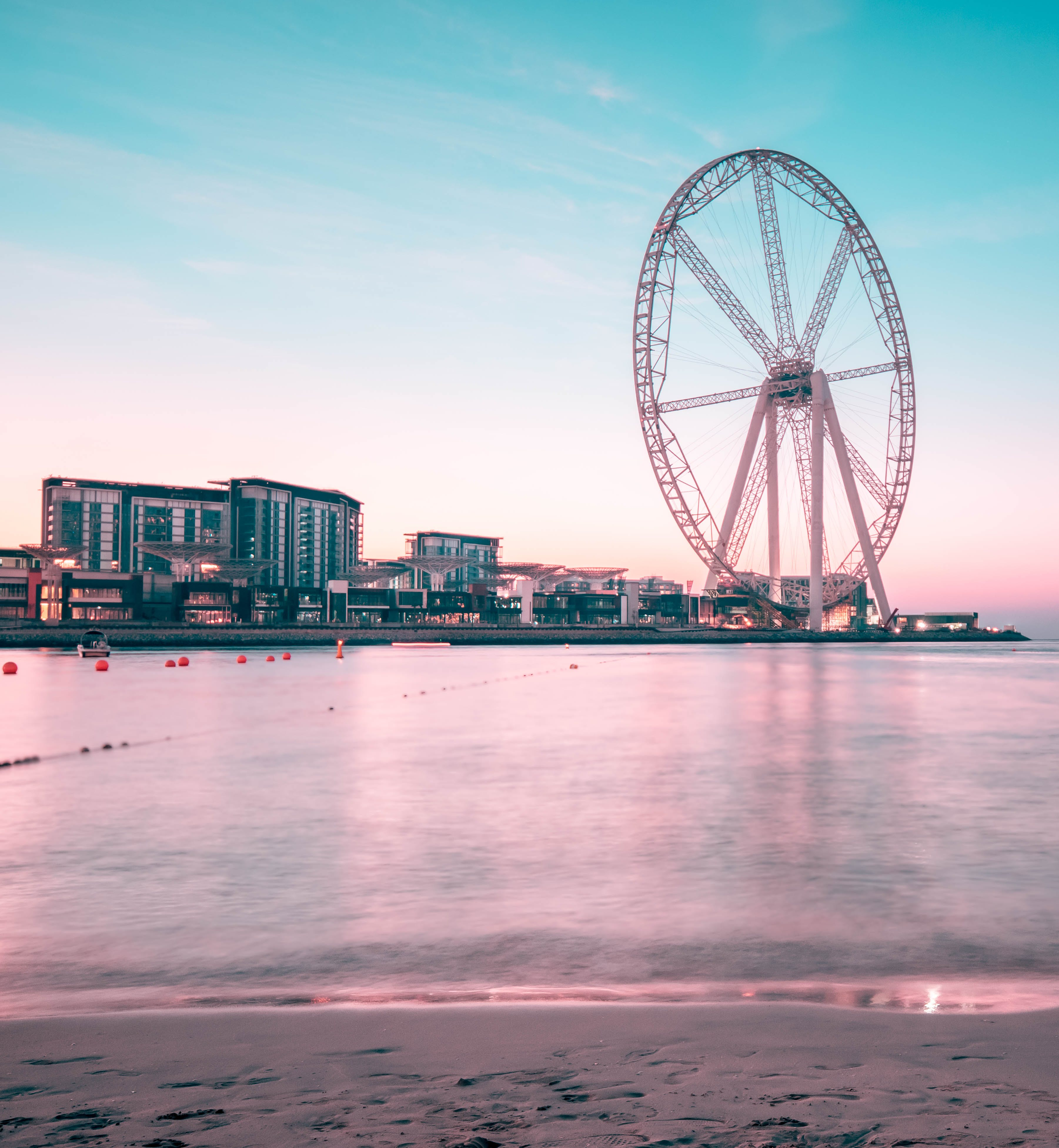 Ferris Wheel Near Body of Water and High Rise Building