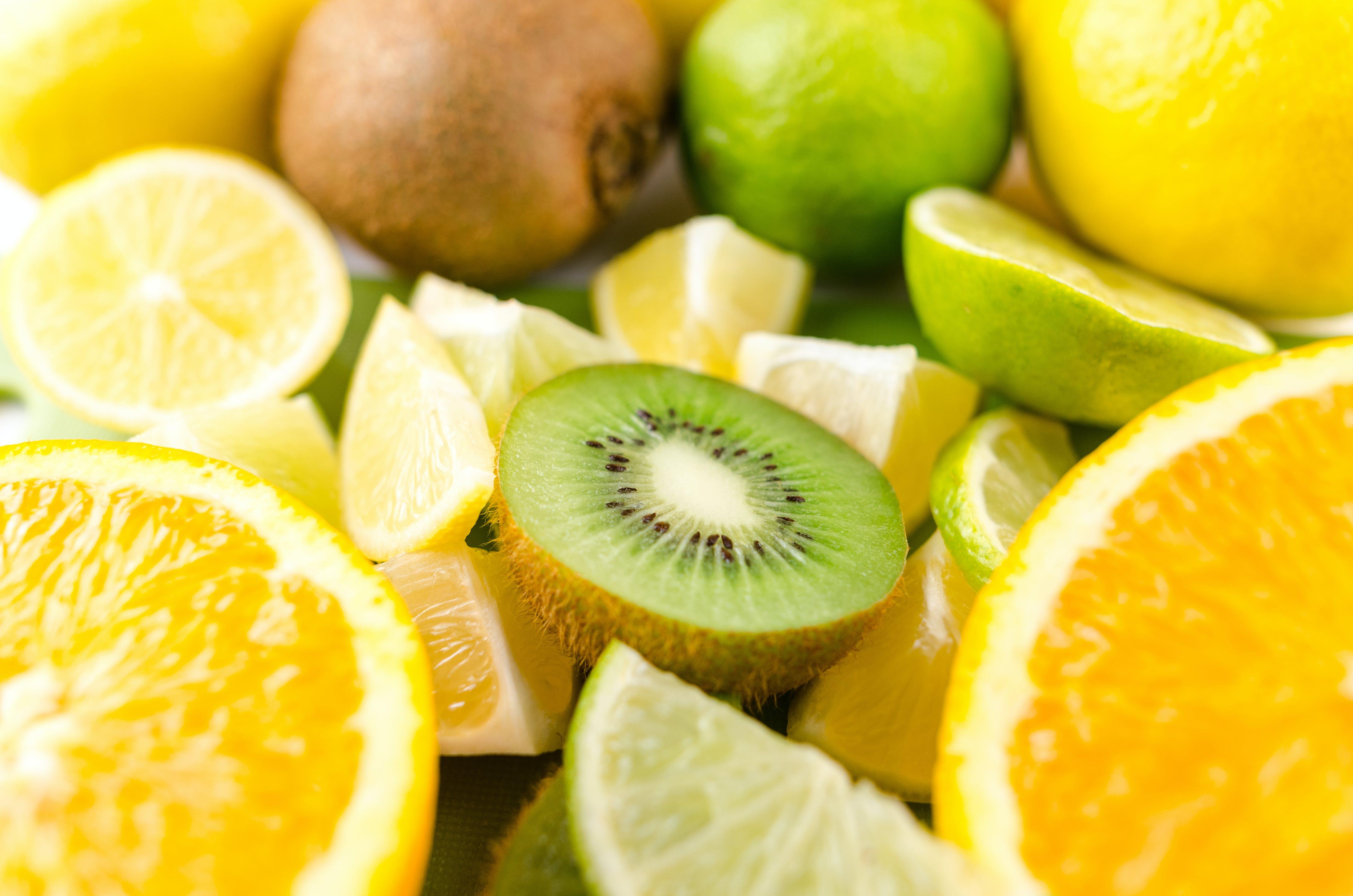 Photo of Slices of Kiwi, Lime, and Orange Fruits