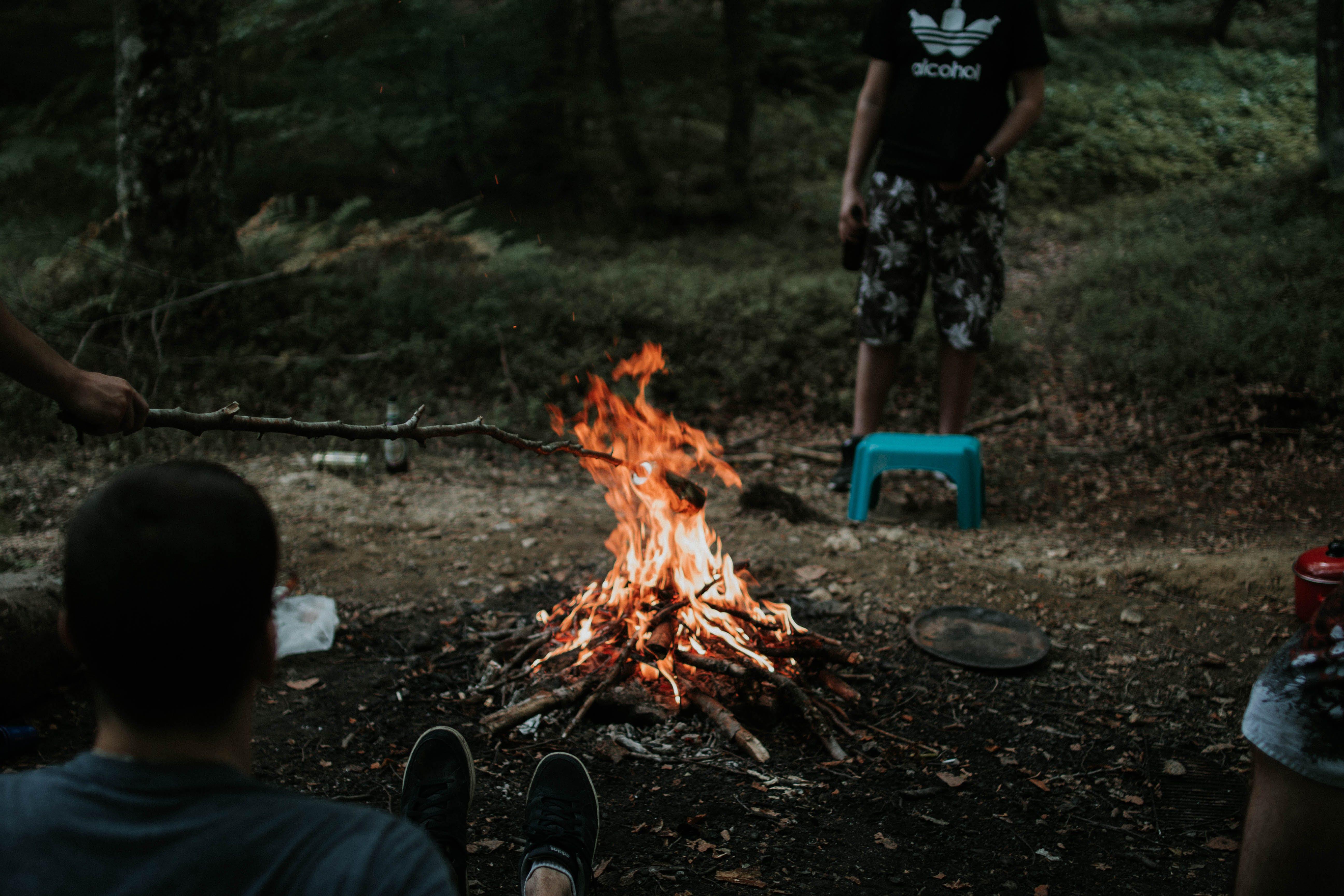 Man Sitting Near Bonfire
