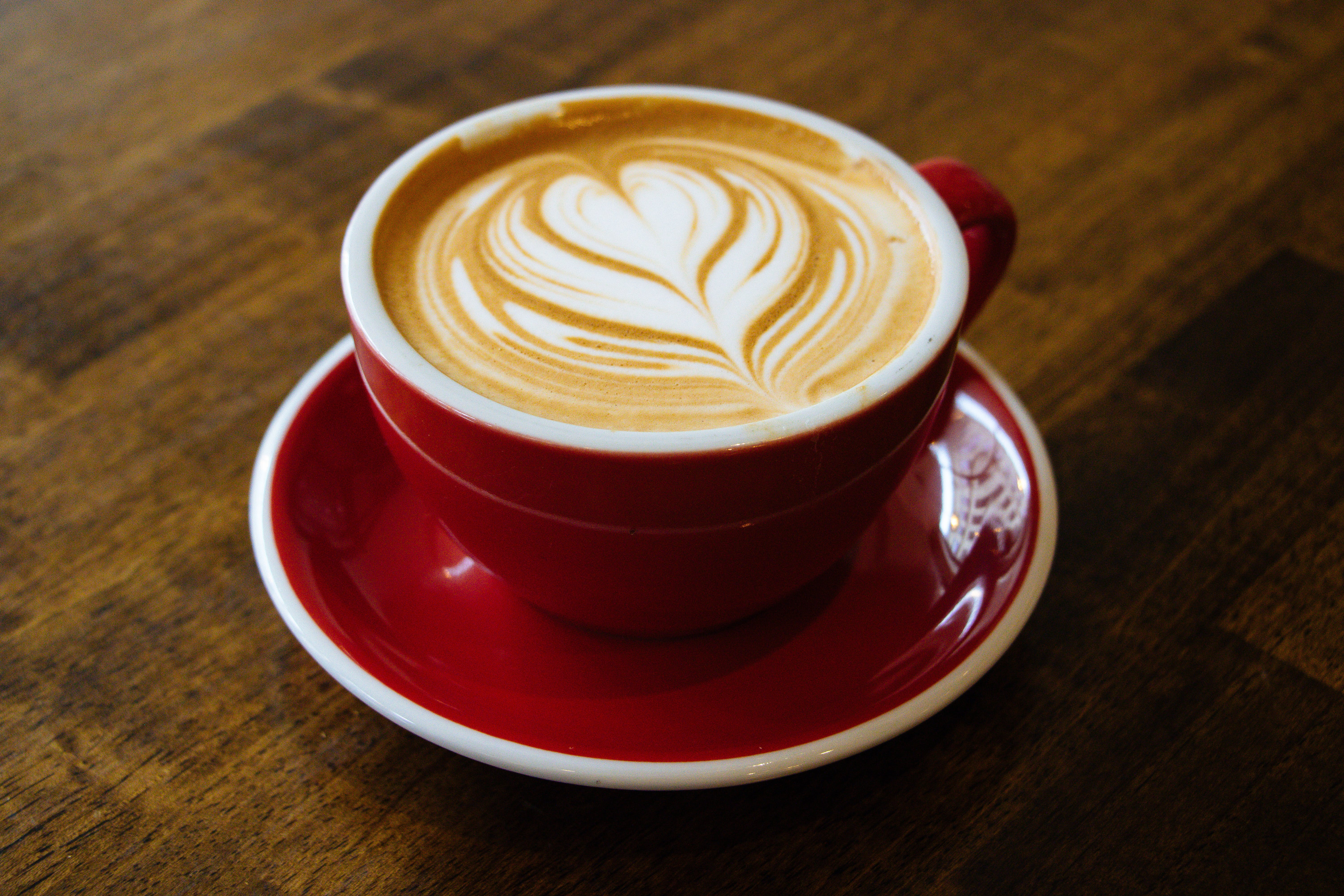 Cappuccino-filled Cup on Red Saucer