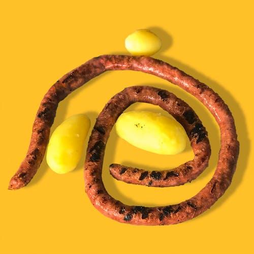 Foto d'estoc gratuïta de alemany, àpat, botifarra, menjant