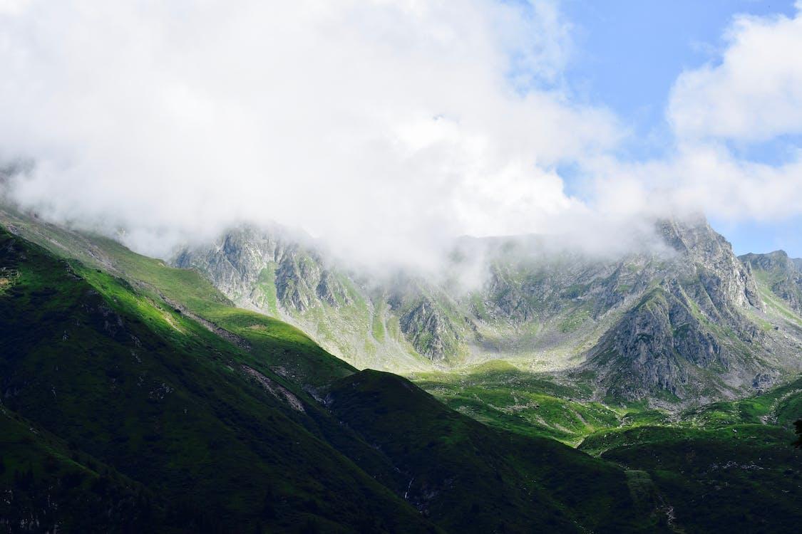 Green Mountain Under Cloudy Blue Sky