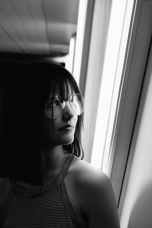 Grayscale Photo of Woman Wearing Aviator-style Eyeglasses
