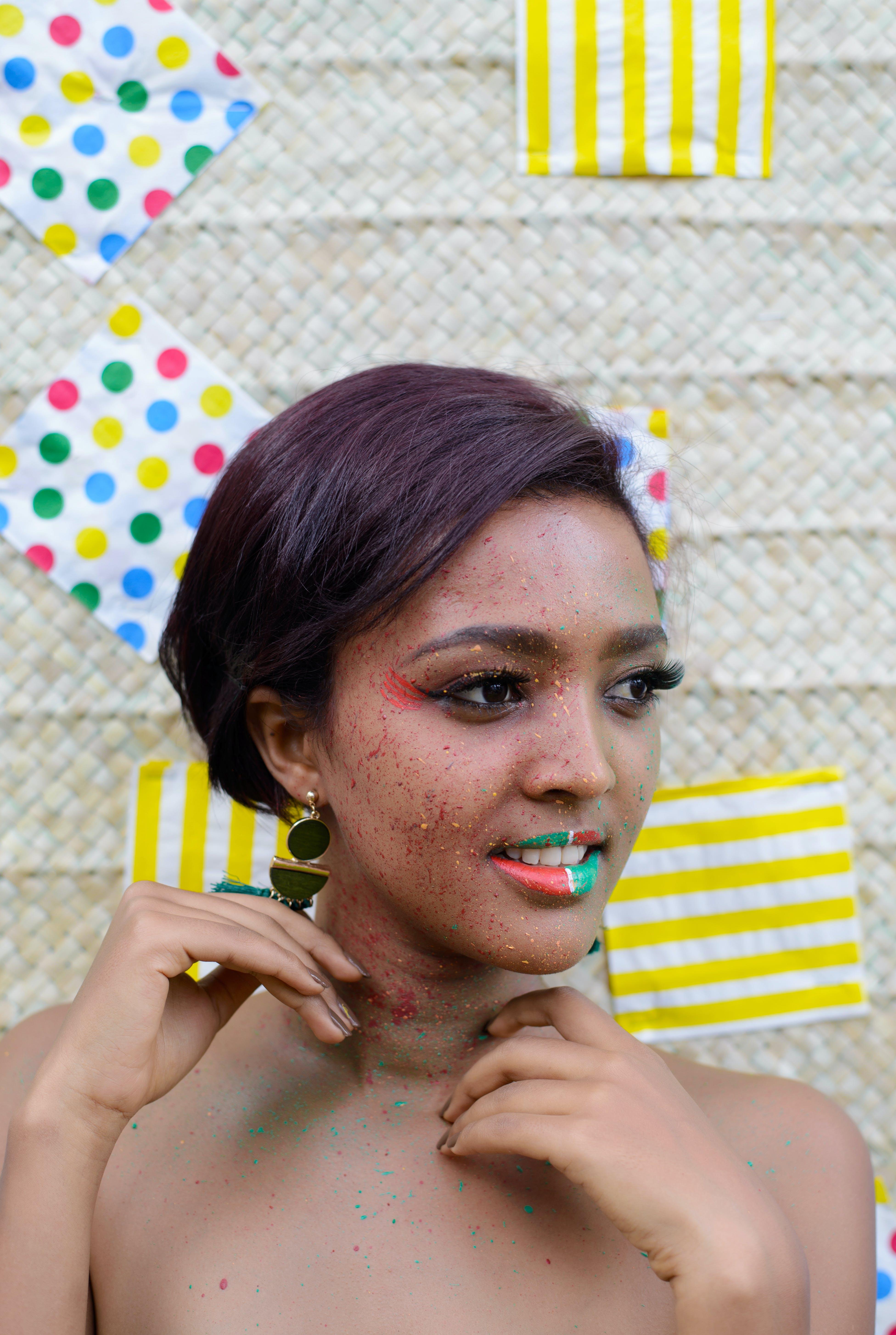 Woman Wearing Green Earrings