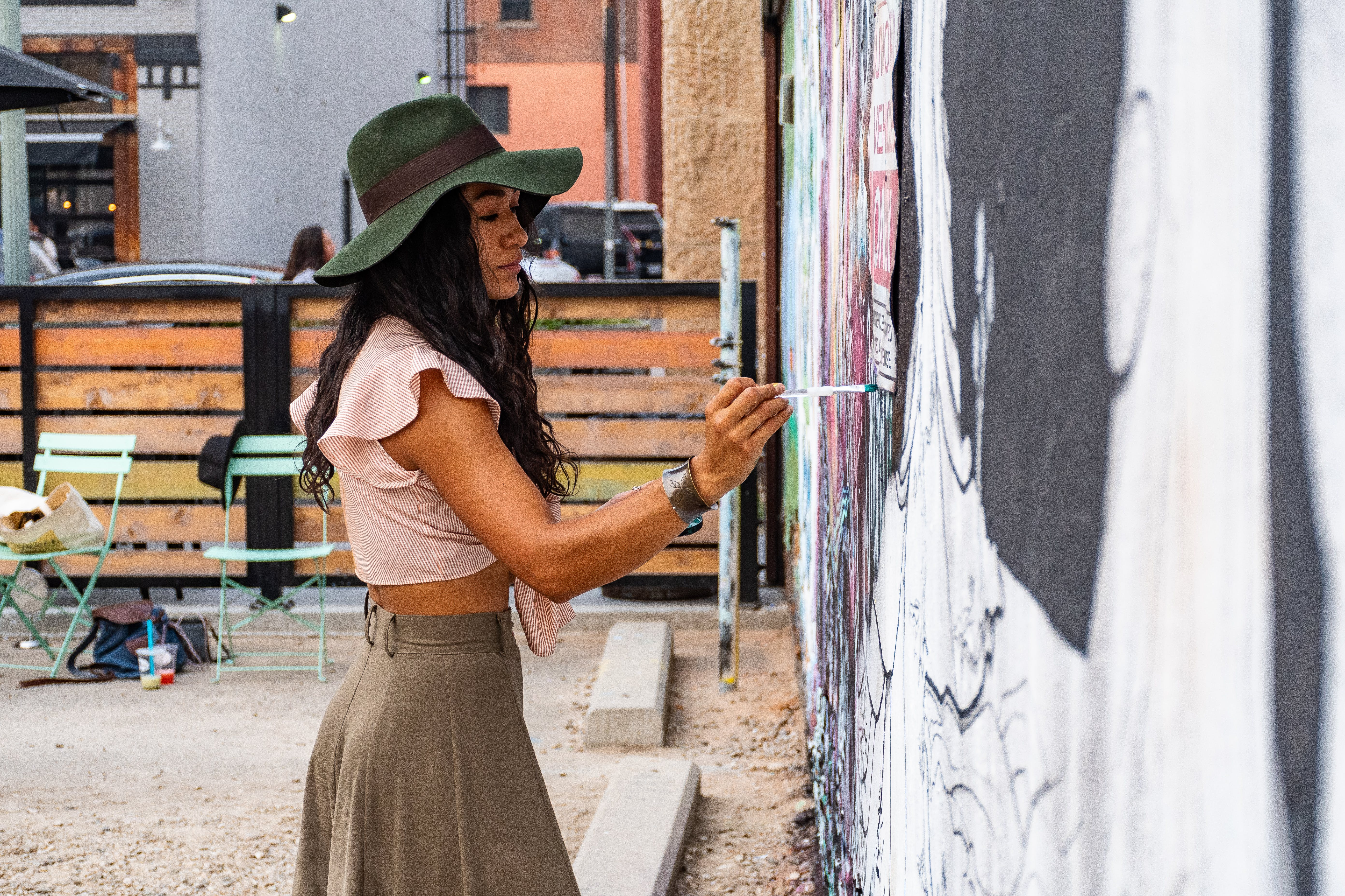 Woman Painting on Wall
