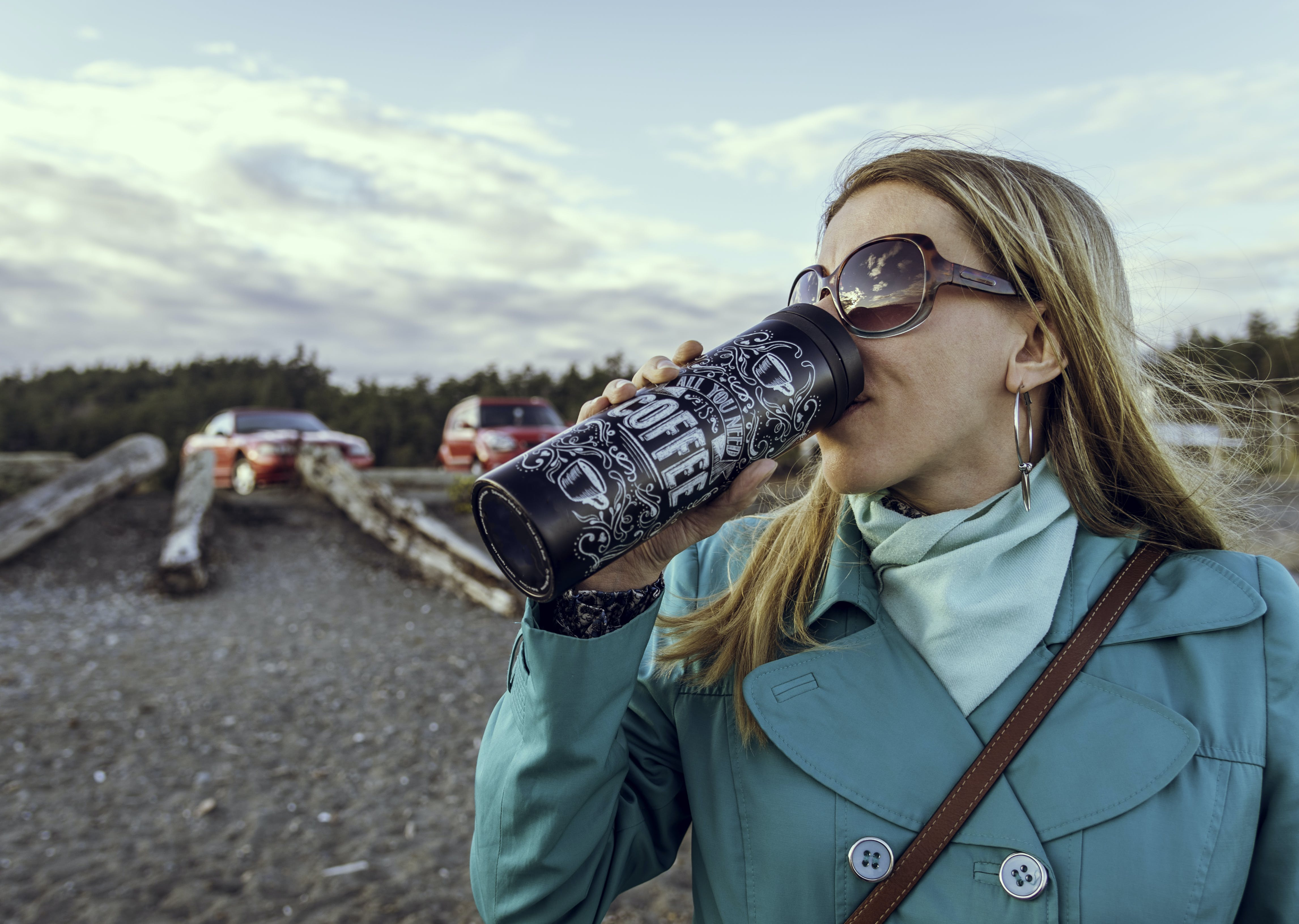 Woman Drinking from Bottle