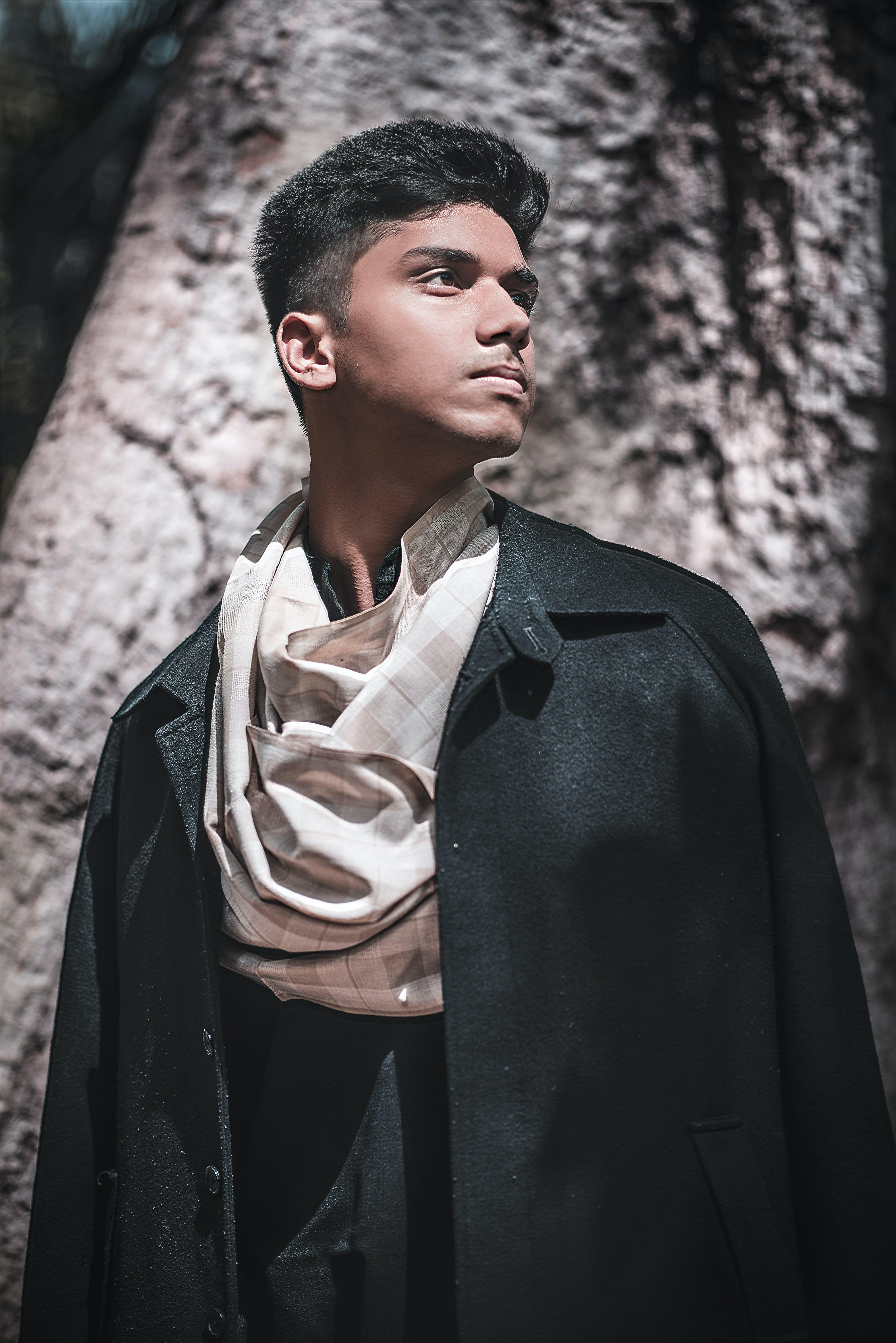 Man Wearing Black Coat Facing Sideways