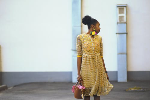 Woman Doing Pose Wearing Yellow Dress