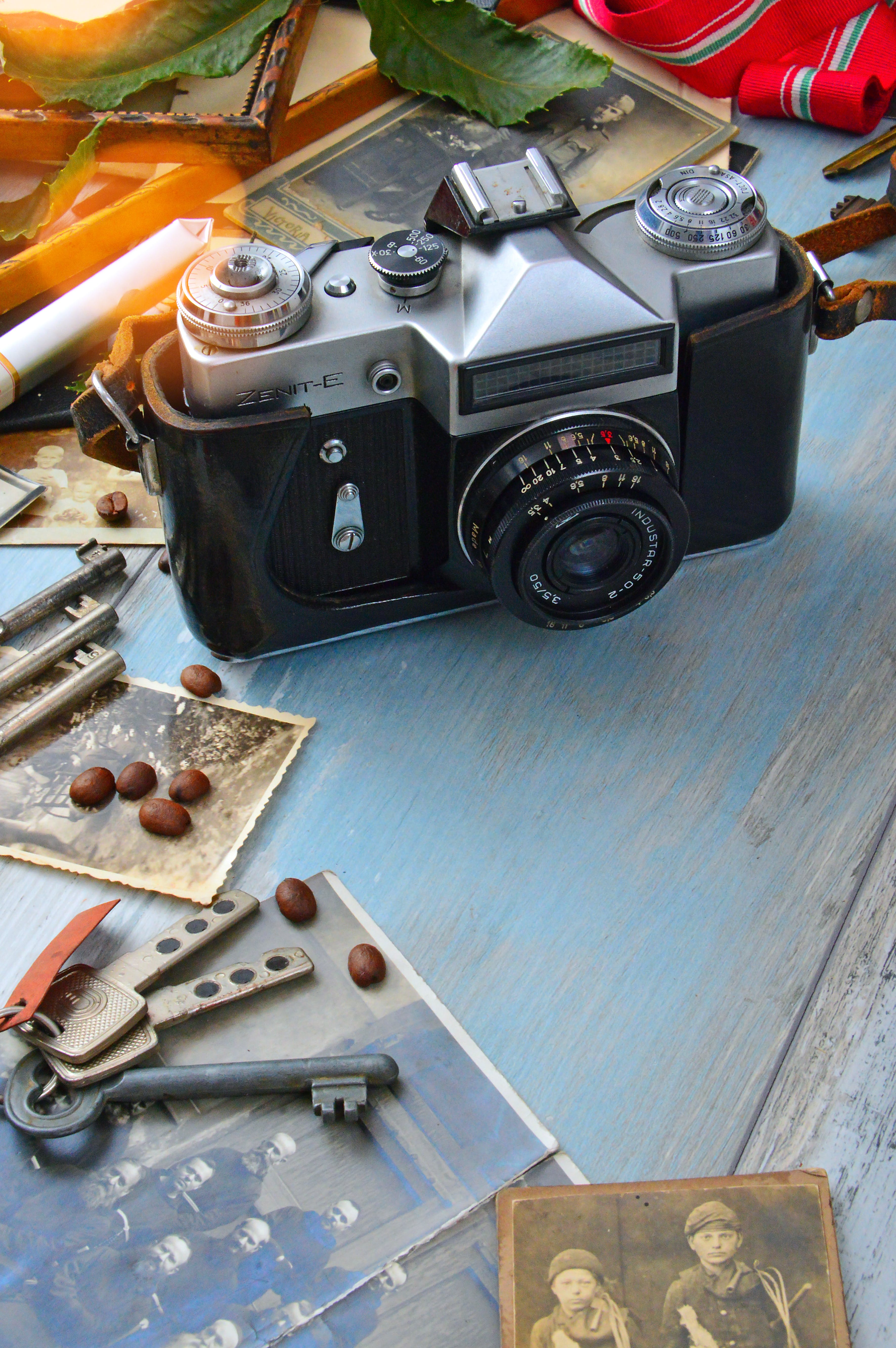 Black Film Camera on Blue Wooden Surface