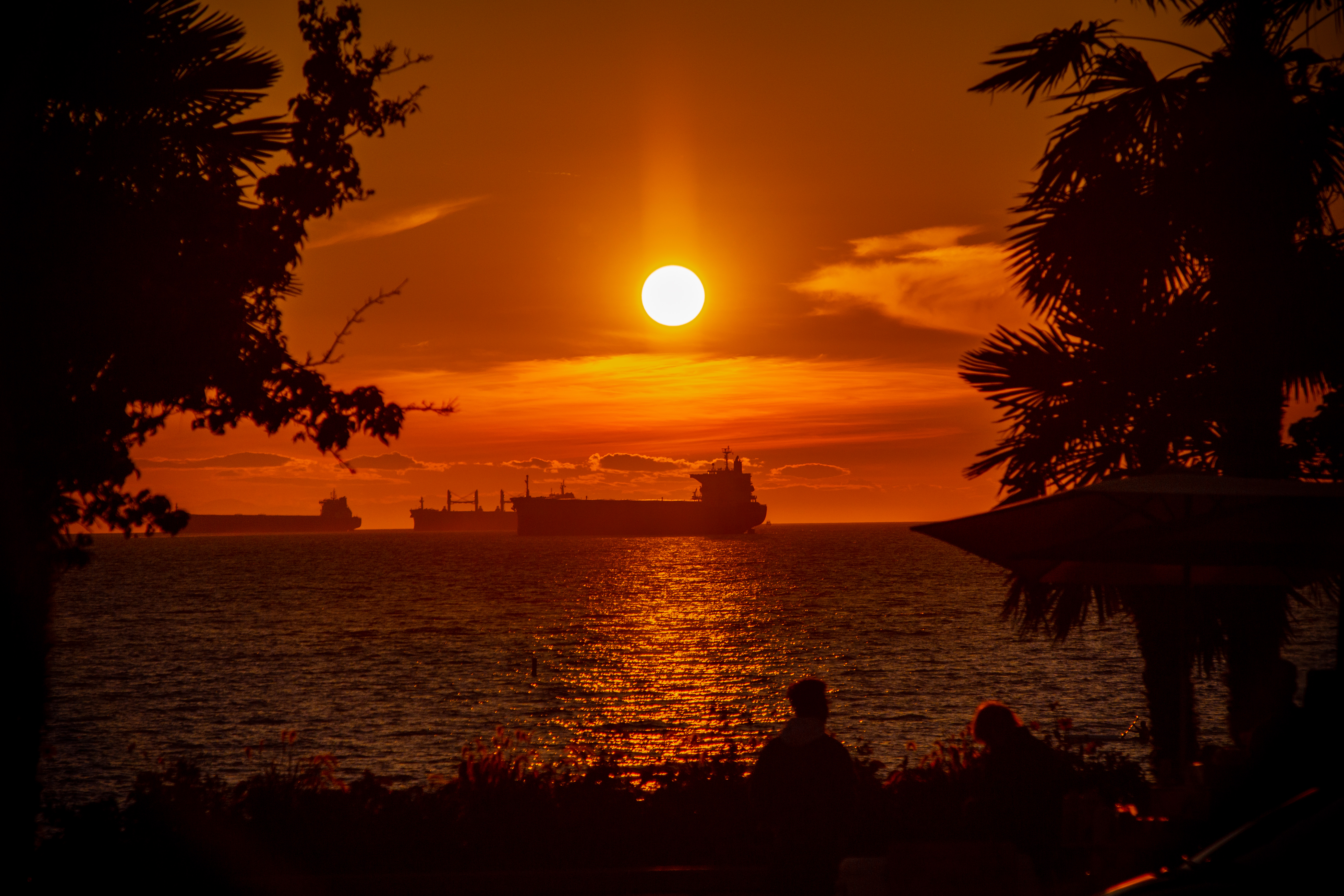 ship on body of water during sunset