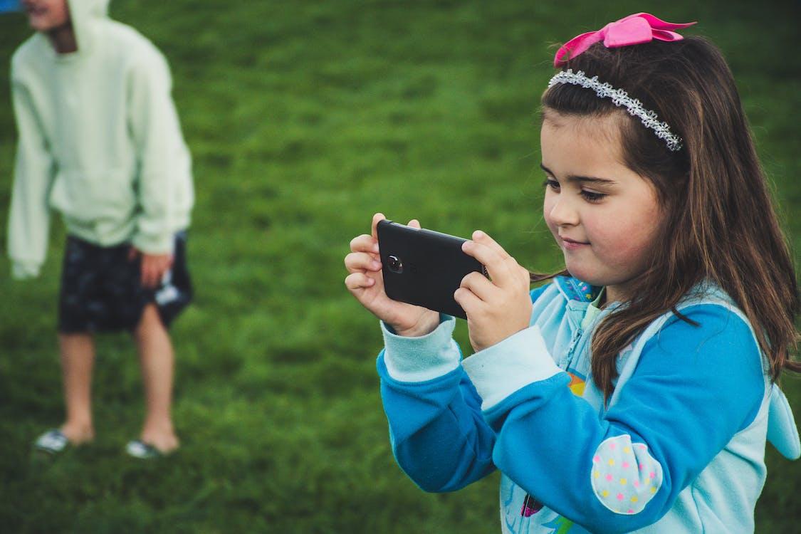 Girl Uses Smartphone