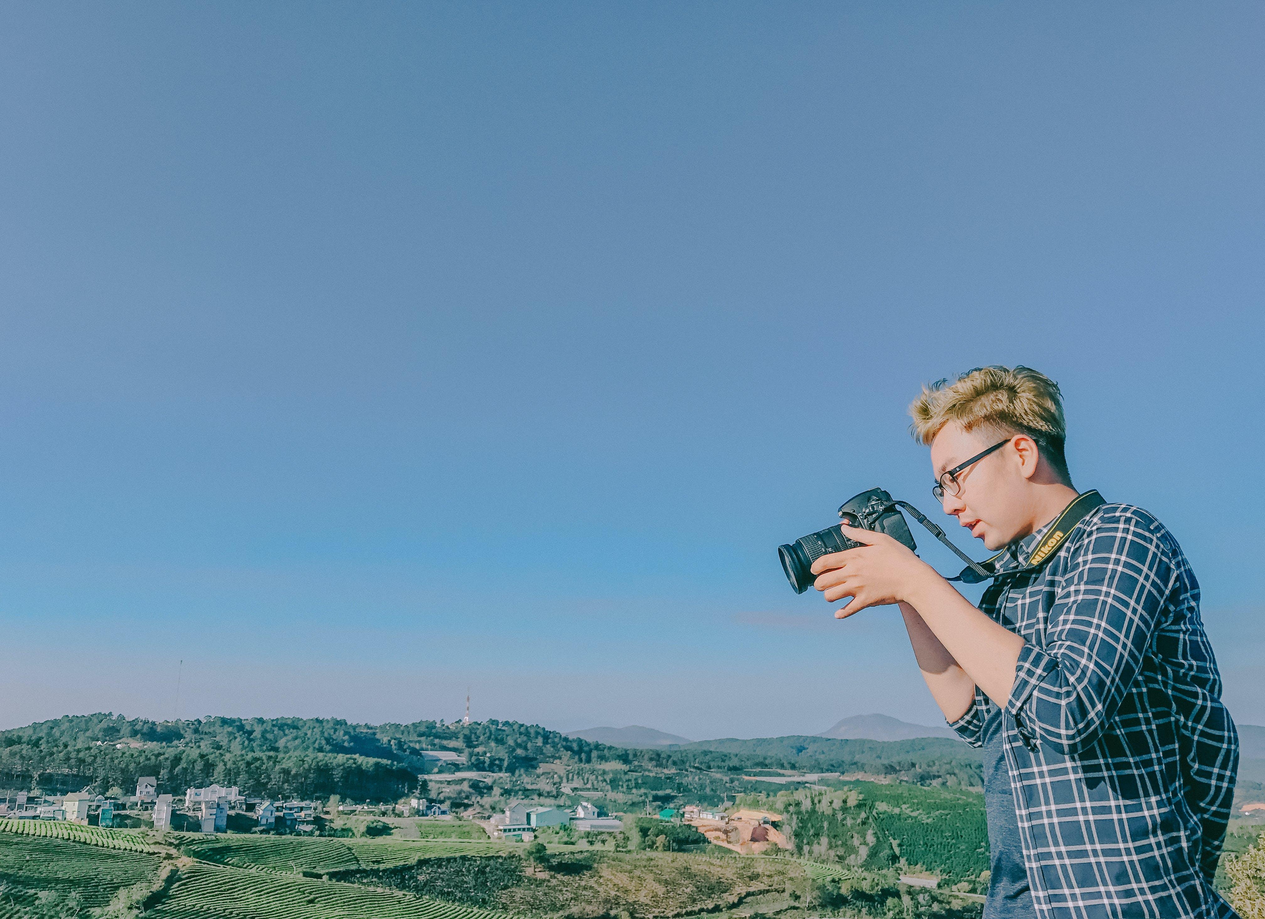 Man Uses Nikon Dslr Camera
