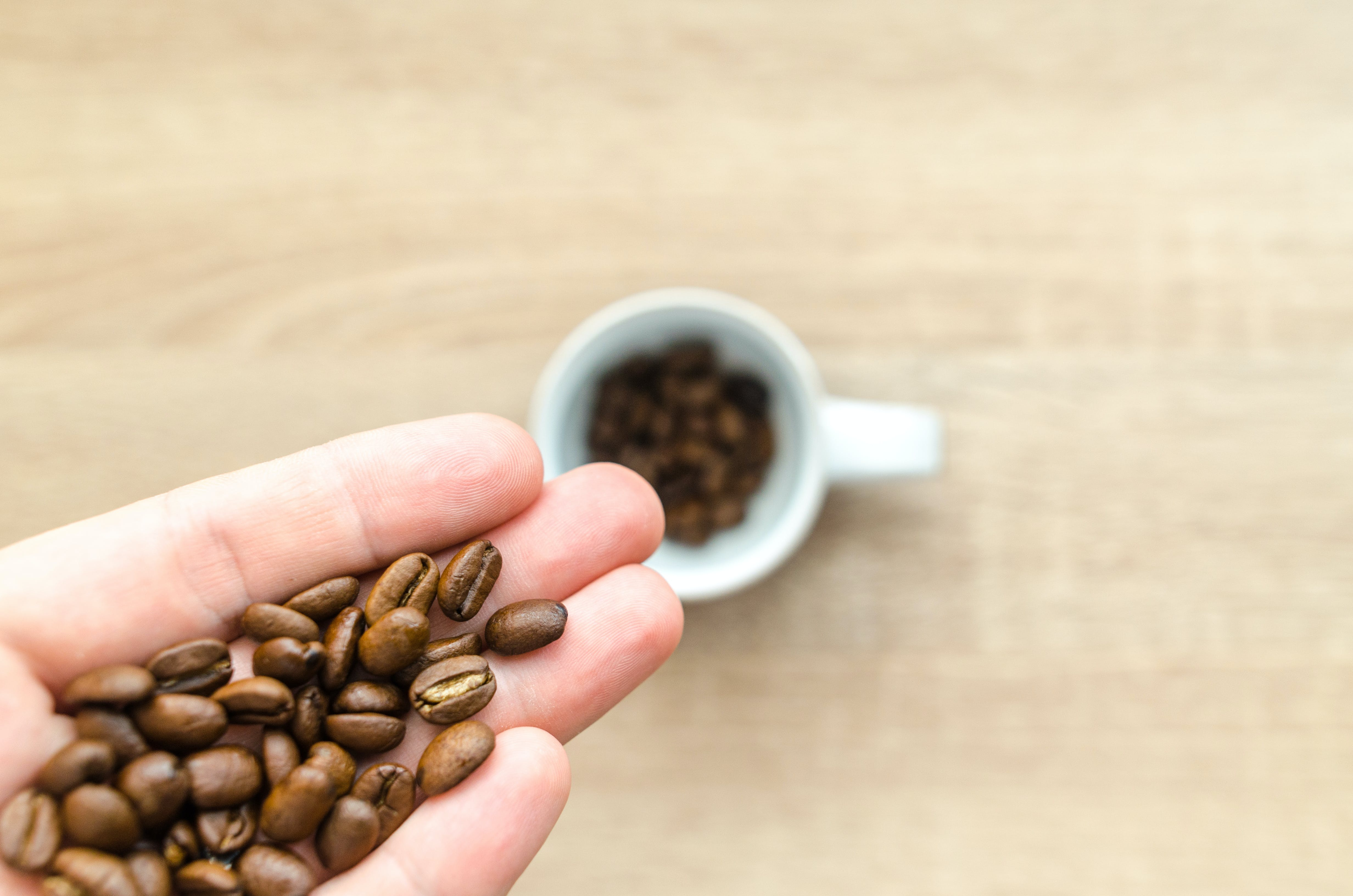 Coffee Beans on Left Hand