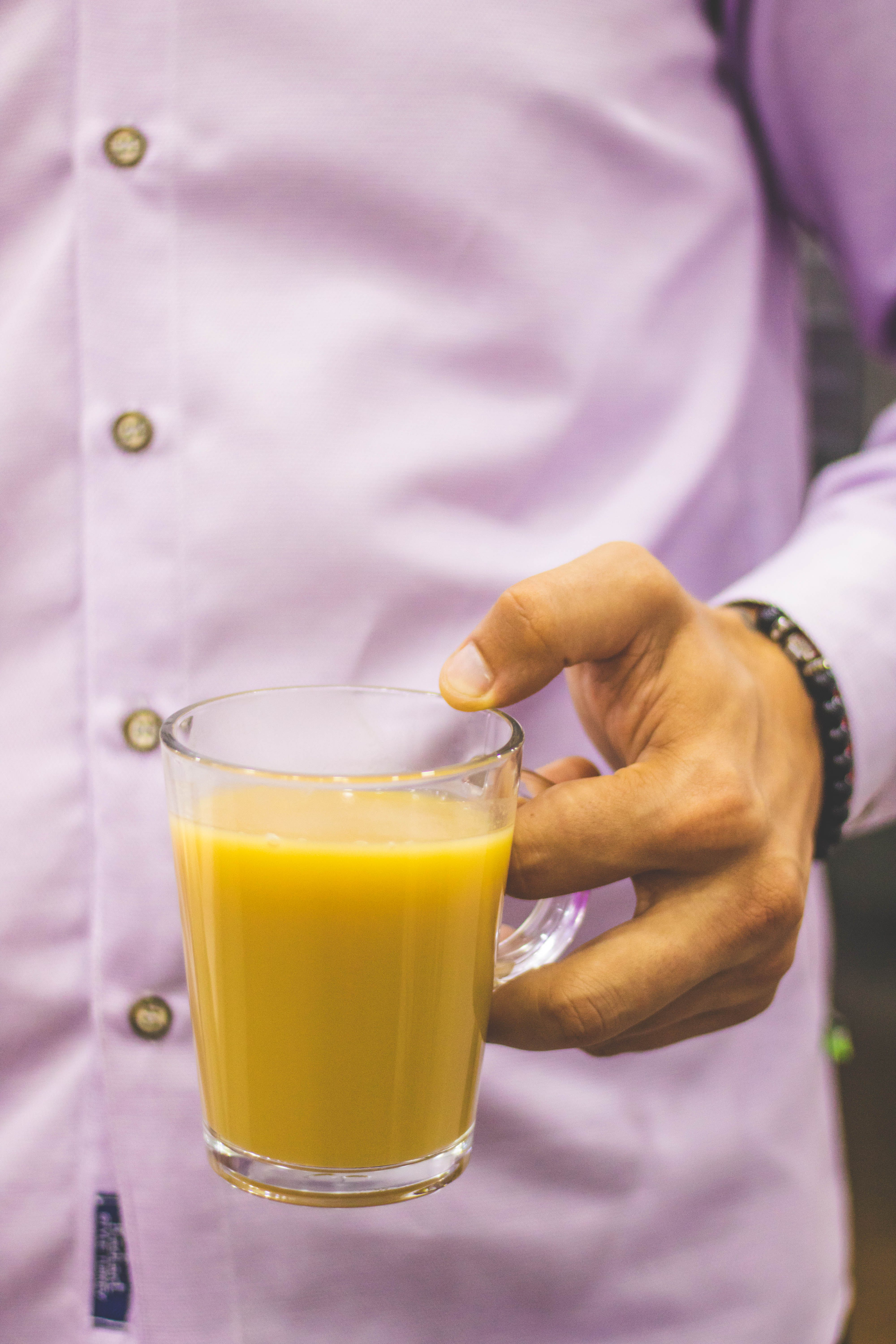 Person Holding Glass Mug Filled With Juice