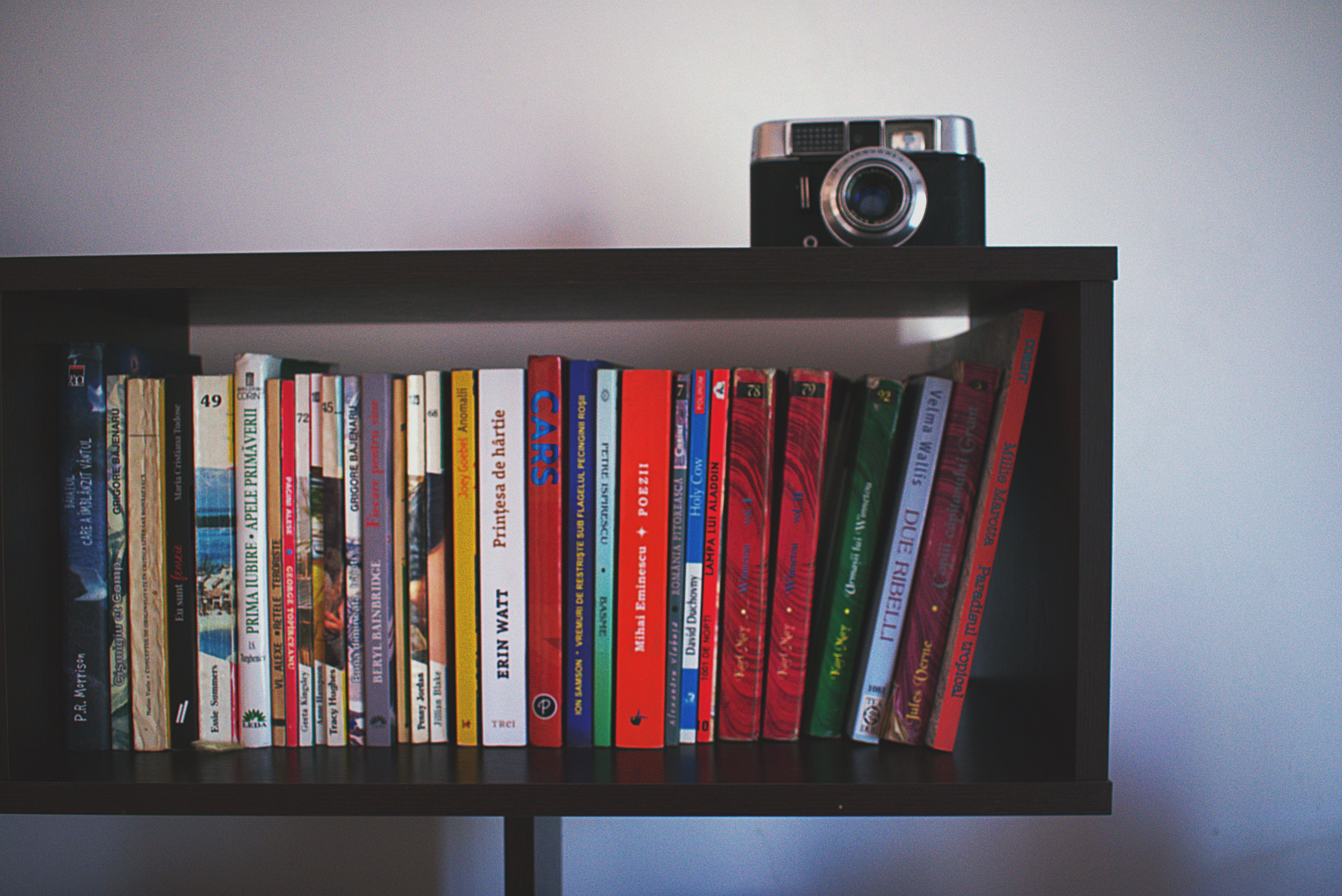 Black Wooden Shelf and Black Camera