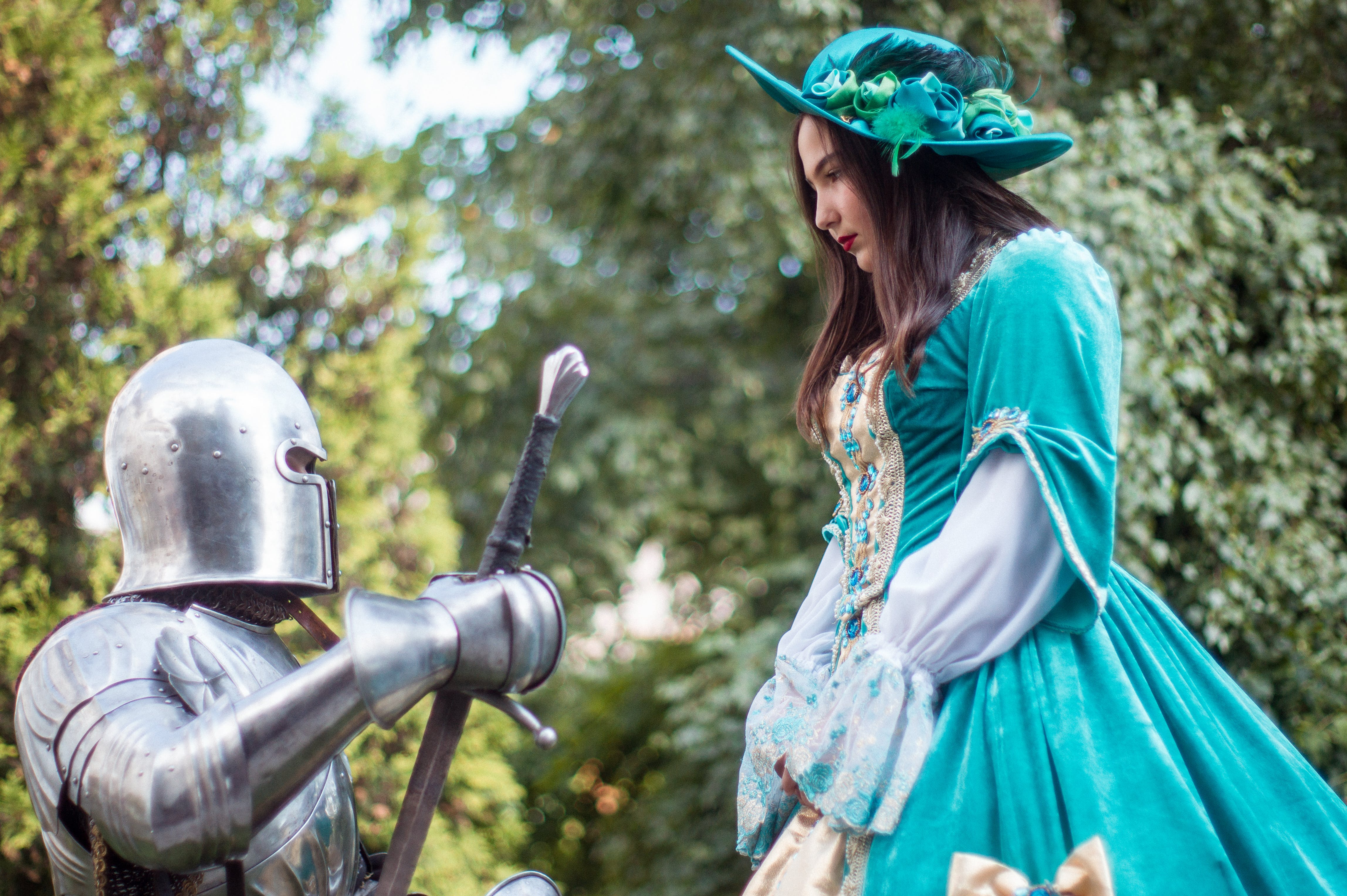 Knight In-front of Woman in Green Dress