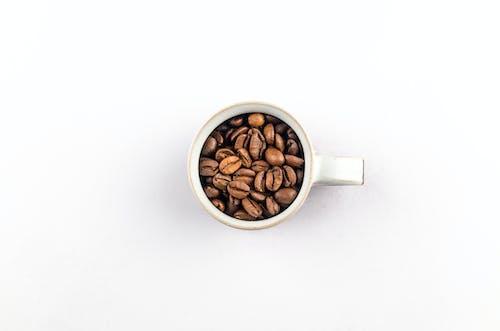 Coffee Beans in White Ceramic Mug