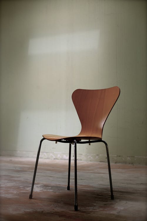 Brown and Black Chair on Brown Surface