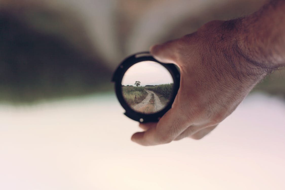 Person Holding Lens Focus Photography