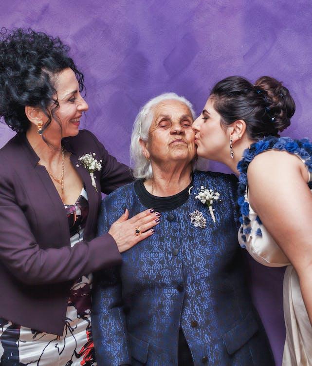 Woman Kissing Woman's Cheek