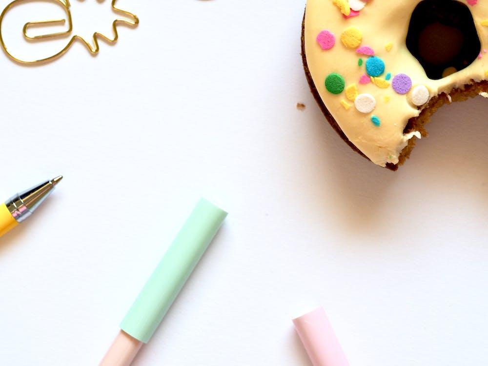 Ballpoint Pen Beside Doughnut
