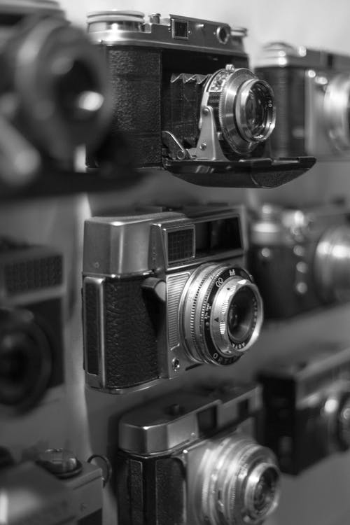 Grayscale Selective Focus Photography of Vintage Camera Lot