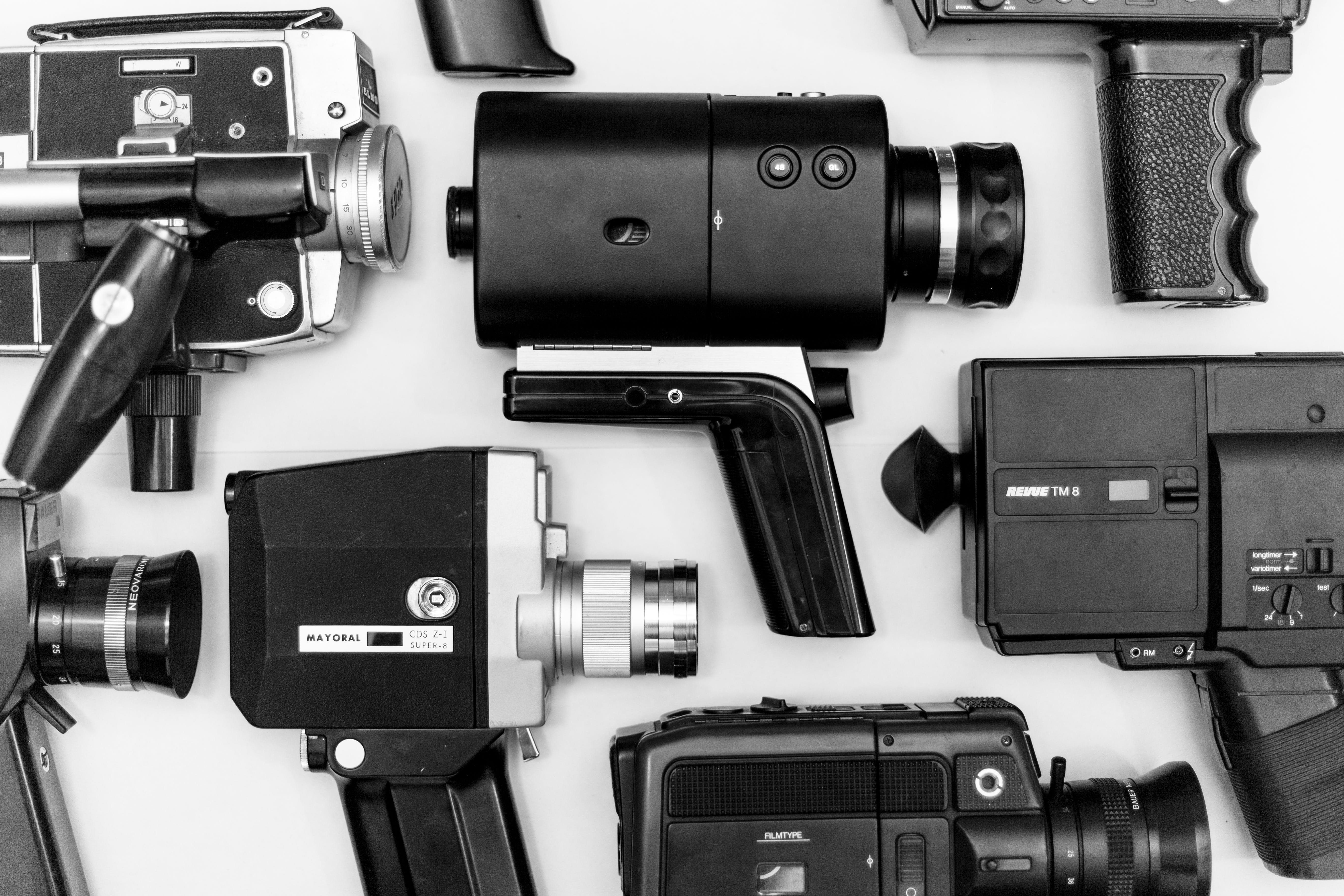 Assorted Camera Lot on Surface in Grayscale Photo
