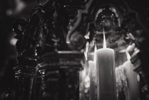 Grayscale of Lighted Candle