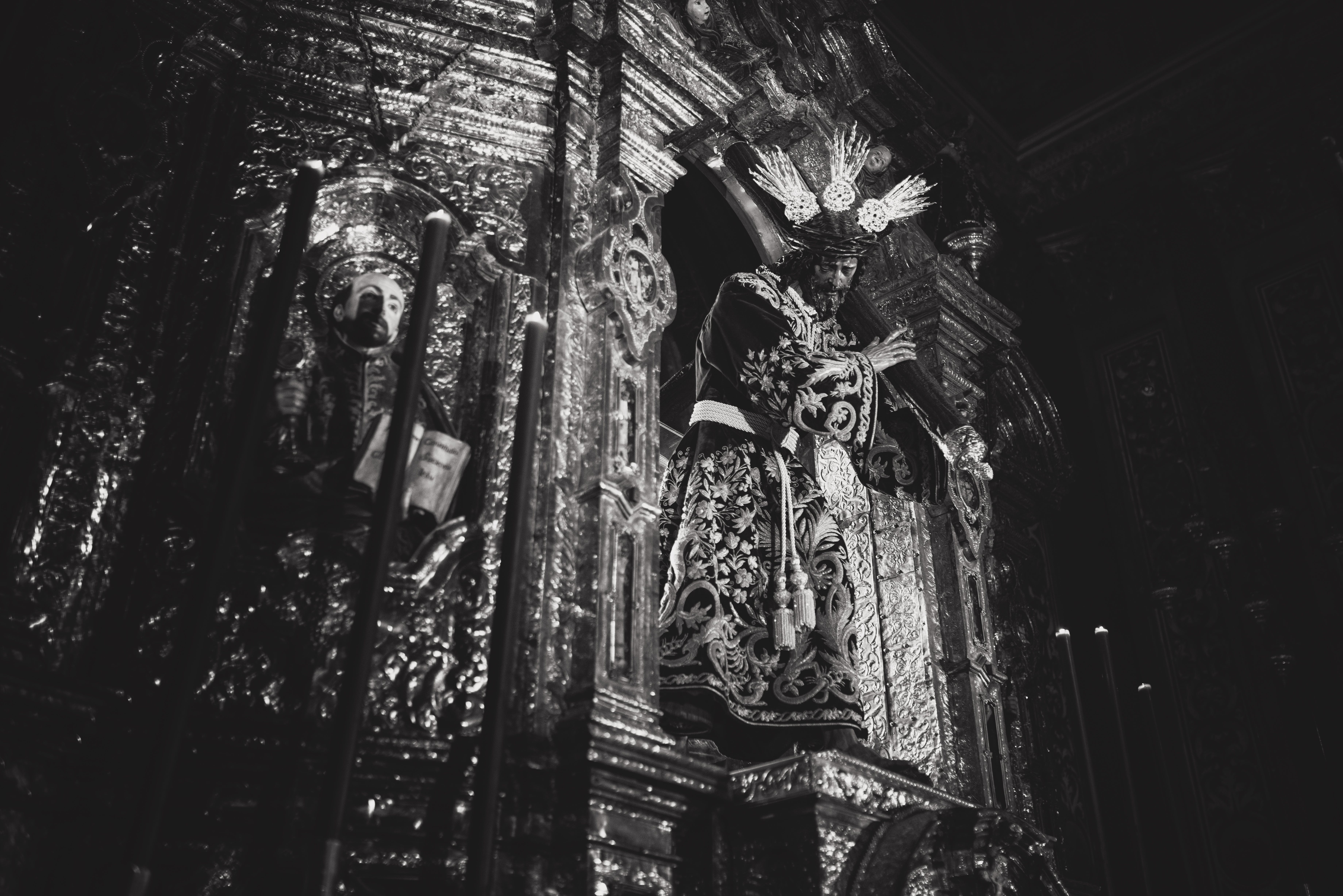 Grayscale Photography of Jesus Christ Carrying Cross Statue