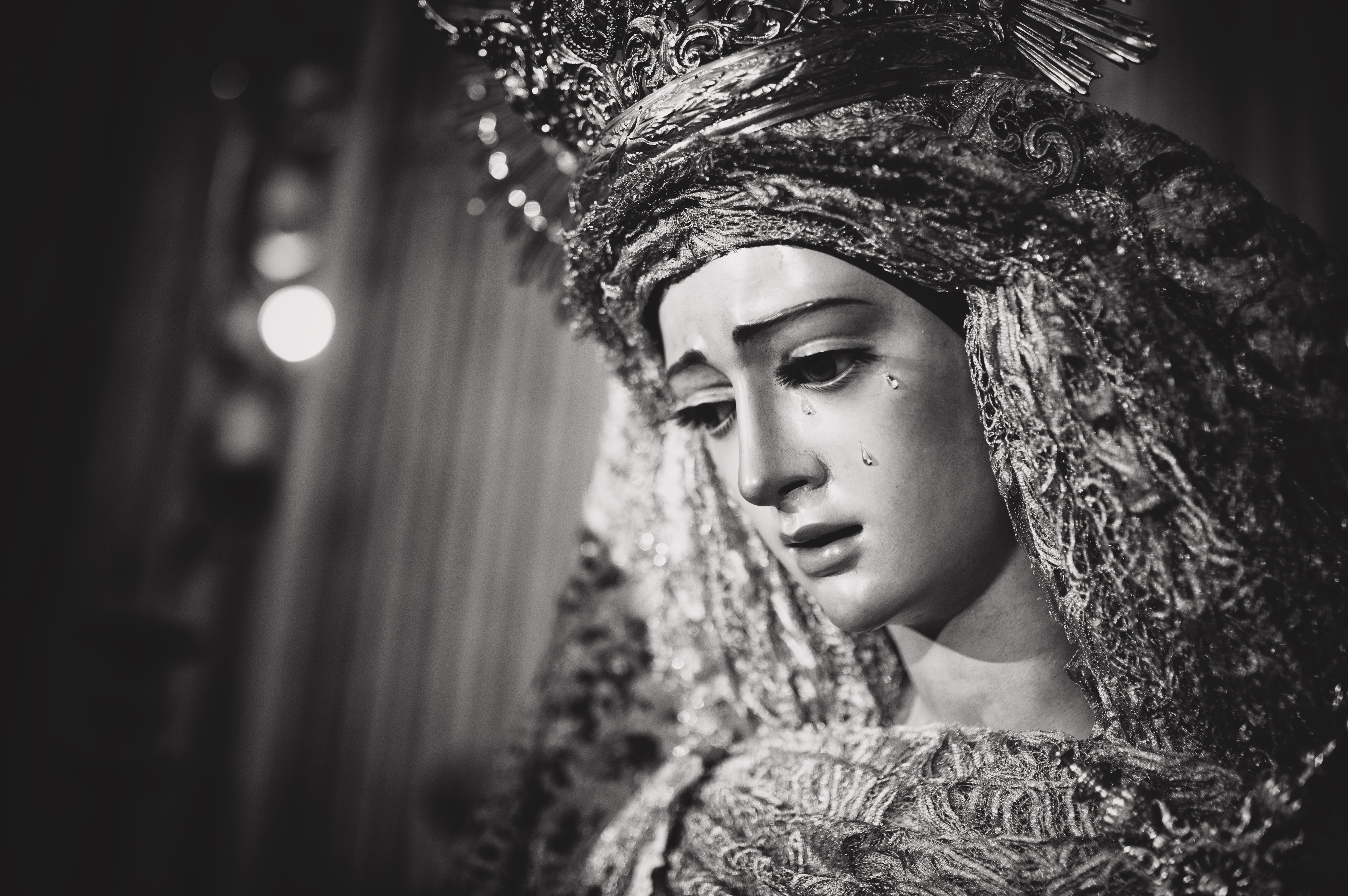 Monochrome Photo of Religious Statue