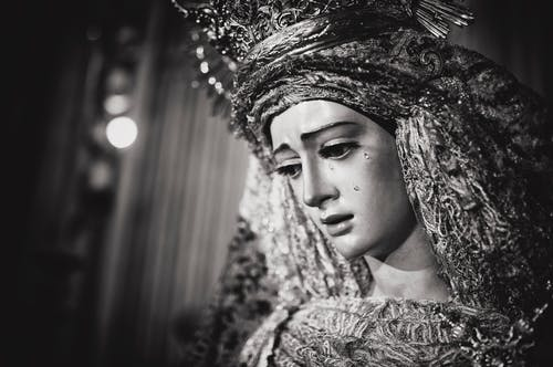 Monochrome Photo of Religious Statue