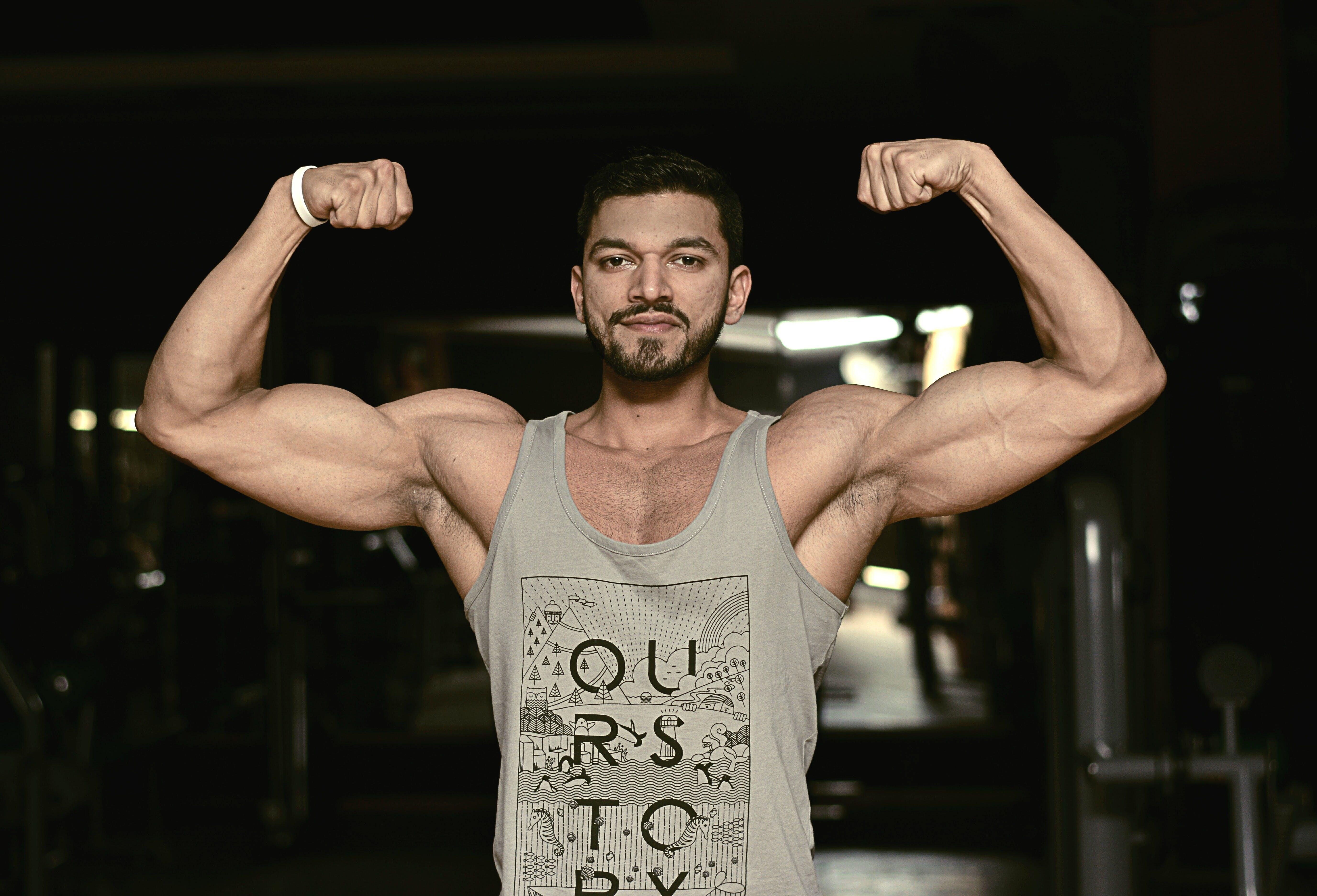 Foto profissional grátis de bíceps, cara, corpo, de boa aparência