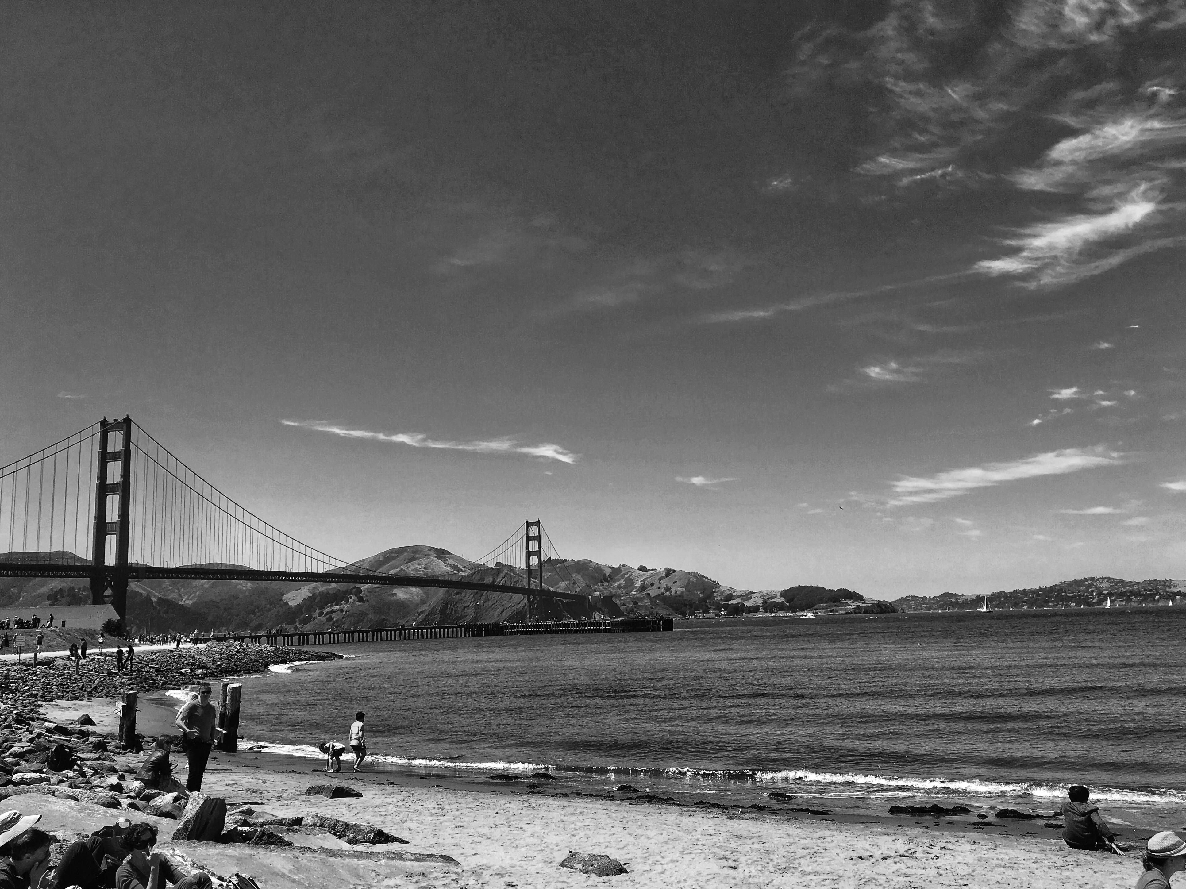 Grayscale Photo of Suspension Bridge