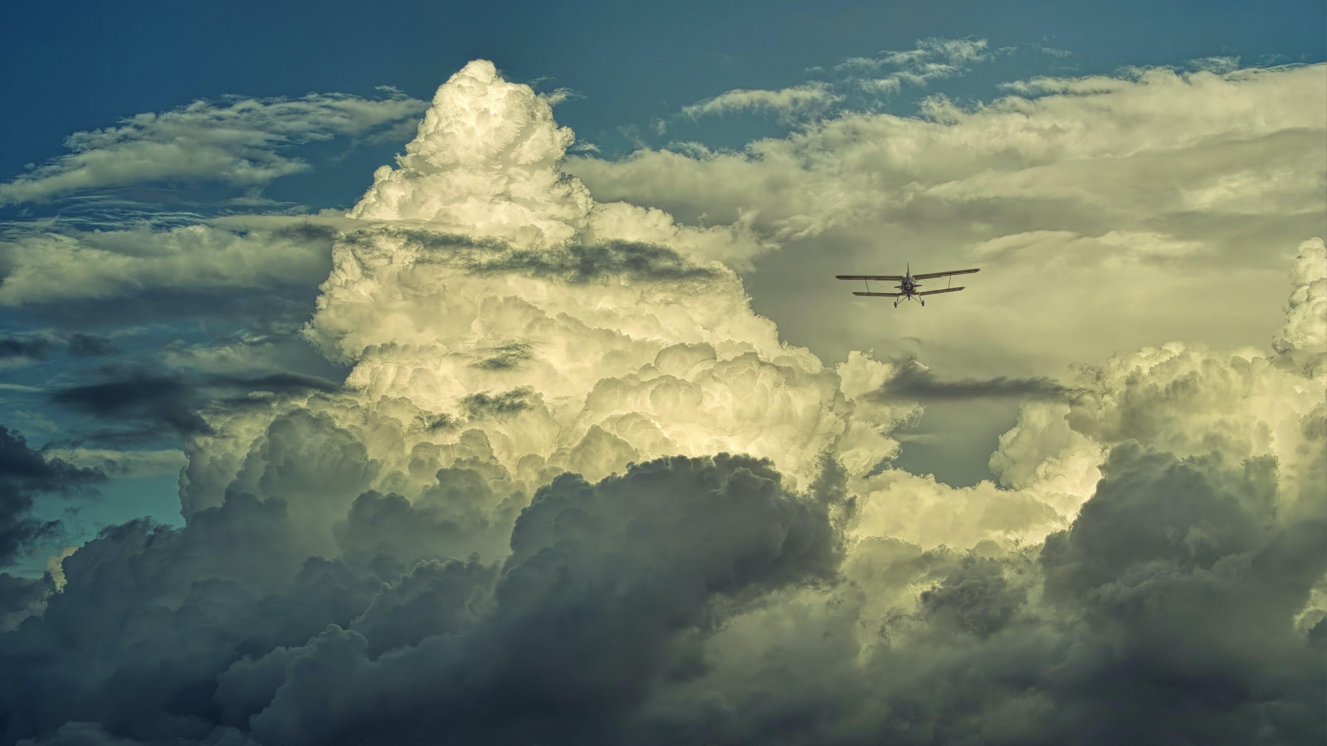 Foto profissional grátis de aeronáutica, aeronave, cênico, céu