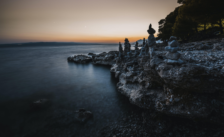 Gray Balance Stone Near the Body of Water