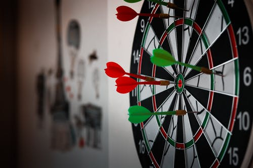 Close-Up Photo of Dart Pins on Dartboard