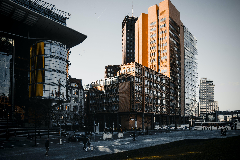 Brown Building Near Orange Painted Building