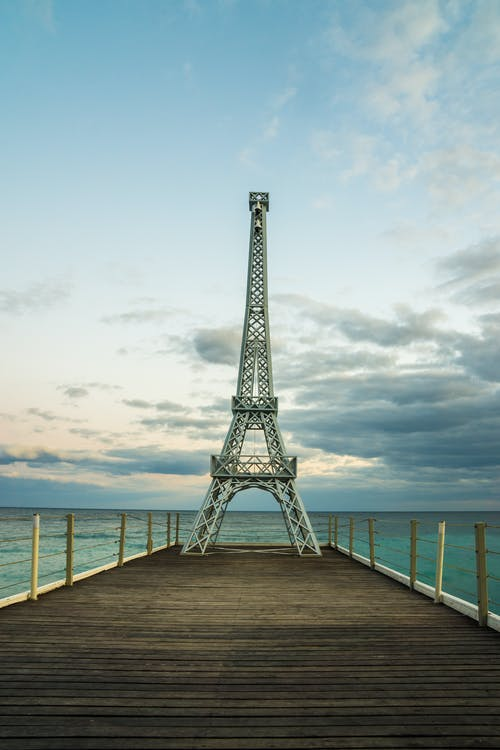 Eiffel Tower Miniature on Wooden Docks