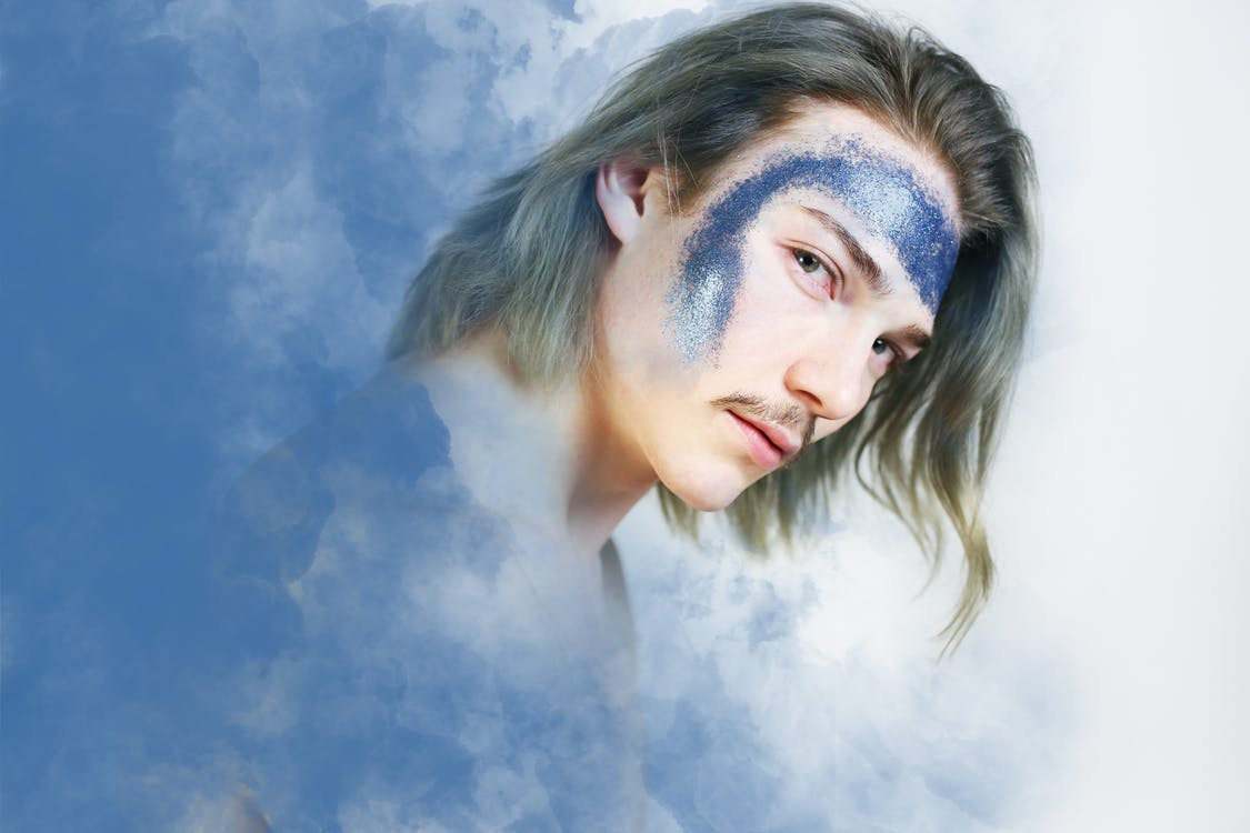 Man's Portrait Photo Against Clouds As Background