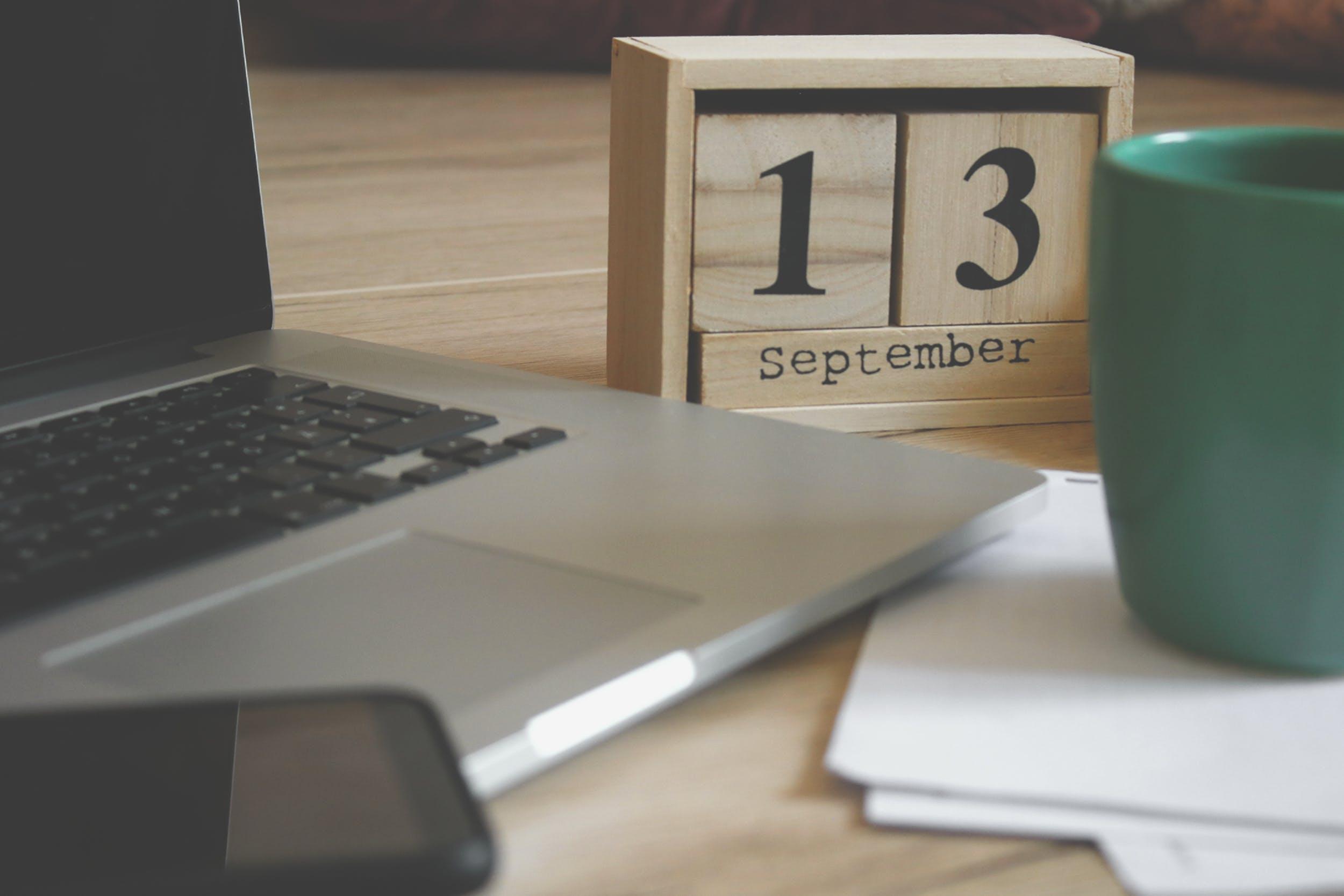 Brown Wooden Block Desk Calendar Displaying September 13