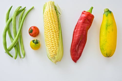 Five Assorted Vegetables on White Surface