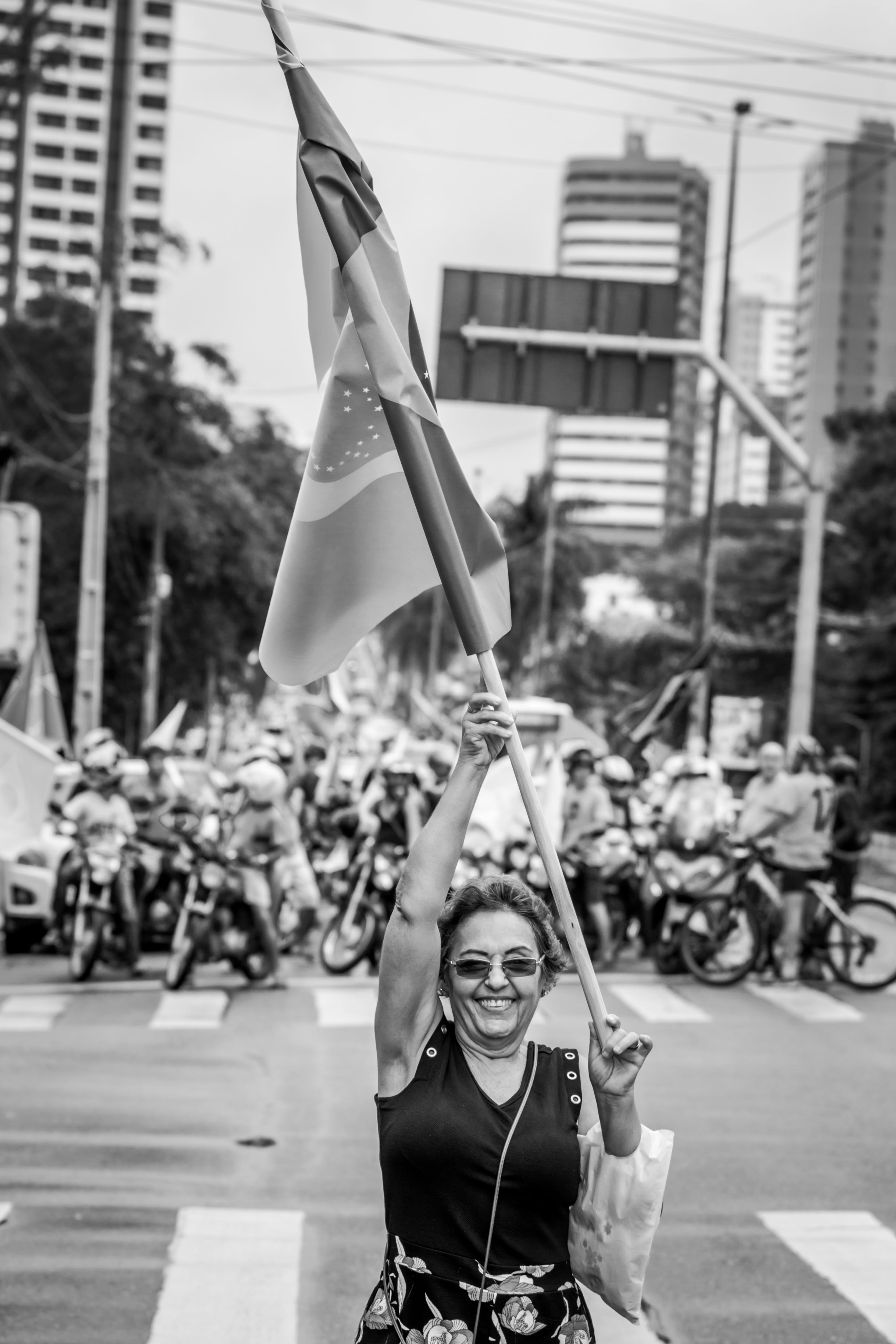 Grayscale Photo of Woman Holding Flag